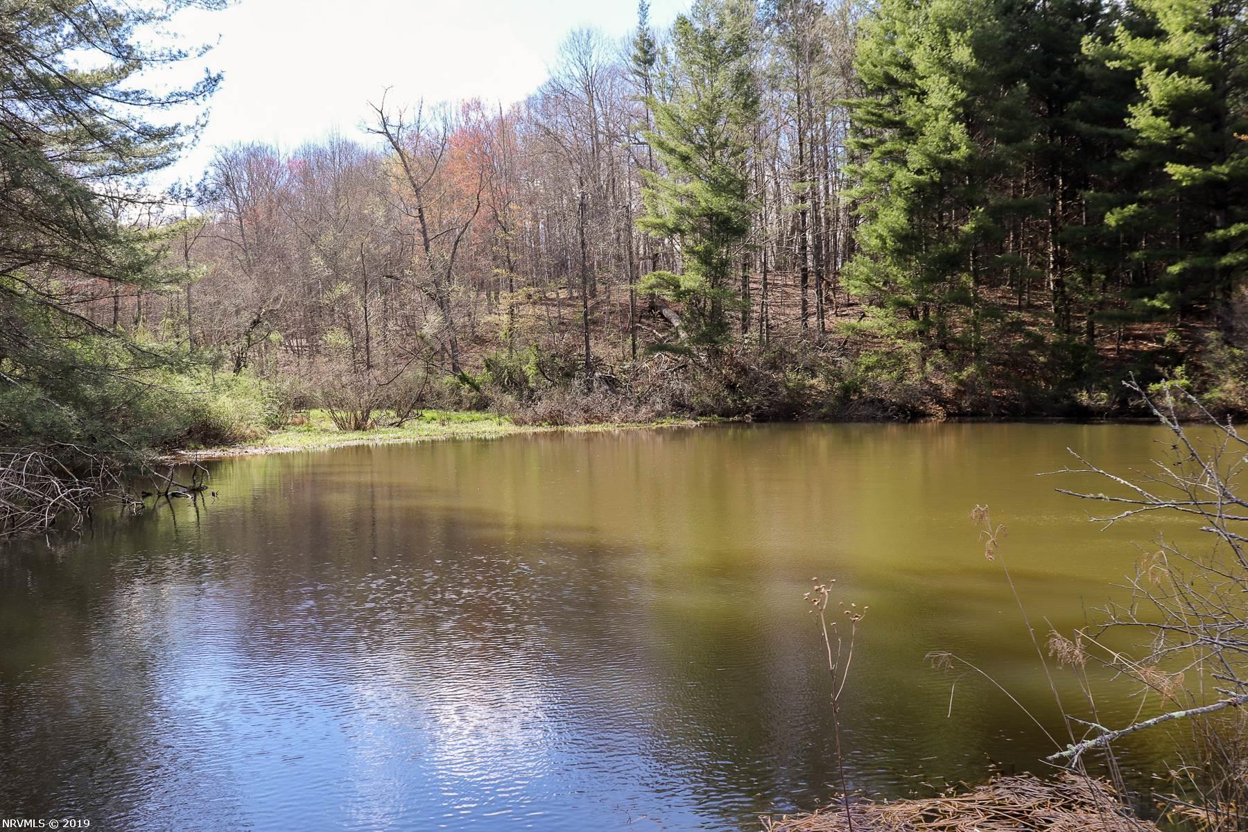 Stunning recreational retreat in Carroll County VA! 127.01 Acres of prime hunting land. The majority of the property is wooded but has a large open flat field with a stream running through. There is a little over 2300 ft of water frontage on West Fork Little Reed Island Creek. This stream is stocked and perfect for trout fishing. Head up the gravel driveway to the beautiful cabin which was hand built by the current owner around 20 years ago. The home has 2 bedrooms and a loft. Also has 2 full baths. Big open area with large windows which provide an abundance of natural light. There is a full unfinished basement, perfect for storage and hunting equipment. Property continues up the mountain w/ trails for ATV's. Killer view up on top as well. Don't miss your opportunity for this amazing place