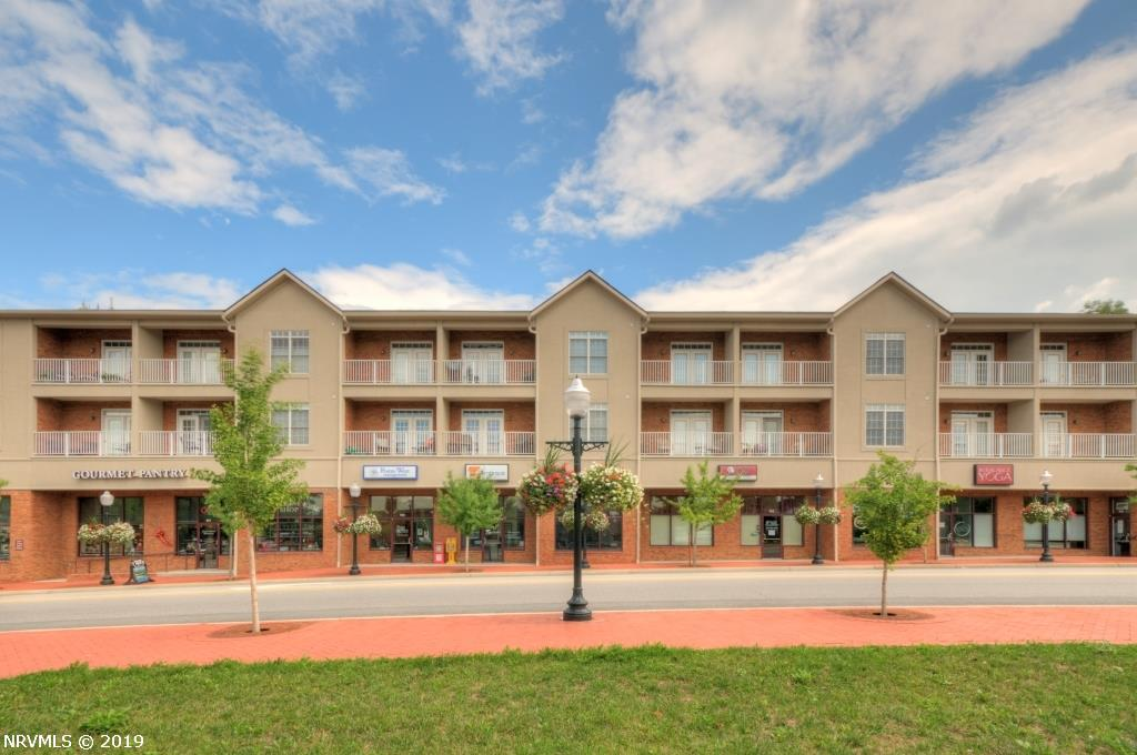 Unique Clay Court Condo.  One of only 4 loft units, this 2 story one and a half bath condo boasts over 1,400 square feet!  Enjoy the gorgeous view of Downtown, Virginia Tech and the  mountains from the deck.  Large windows bring in lots of sunlight for a bright and airy feel.  Builder upgrades include stainless appliances, hardwood floors, and custom cabinets.  Beautiful Master Suite with large walk in closet, expansive master bath featuring a steam shower and plenty of custom cabinets for storage. This unit also has a large open kitchen for entertaining and a laundry room with full size washer/dryer and extra storage space for all of your tailgating needs.  Enjoy the ease of Downtown living with low maintenance and relax while walking/biking to dining, shopping and Virginia Tech.  This unit can easily be converted to a 2 bedroom/2 bath with available plans and local contractor.  Contact Listing Agent for more information.