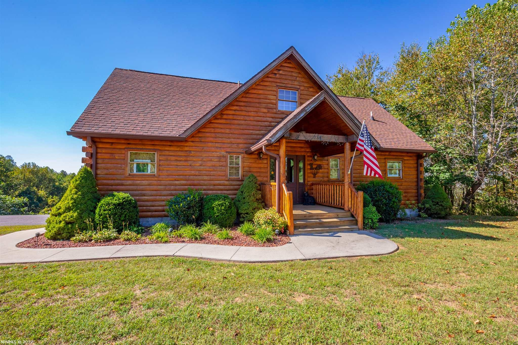 You'll be happy you waited for a chance to see this view! Beautiful, IMMACULATE log cabin on nearly 2.5 acres with some of the best views in Fancy Gap, yet it's in Hillsville and only 10 mins from amenities!! One of the most prestigious neighborhoods in the county. It's just about perfect, 3 beds 3 bathrooms with Master on main level. Beautiful stacked stone fireplace in living room, and gorgeous new windows. Open concept living with laundry on main level as well. You have the perfect amount of privacy so if you're thinking full time living or second home you won't be disappointed with the cathedral ceilings and openness of this cabin. Upstairs you have two bedrooms with builtin dressers and bathroom. Don't wait! This one won't last!!!