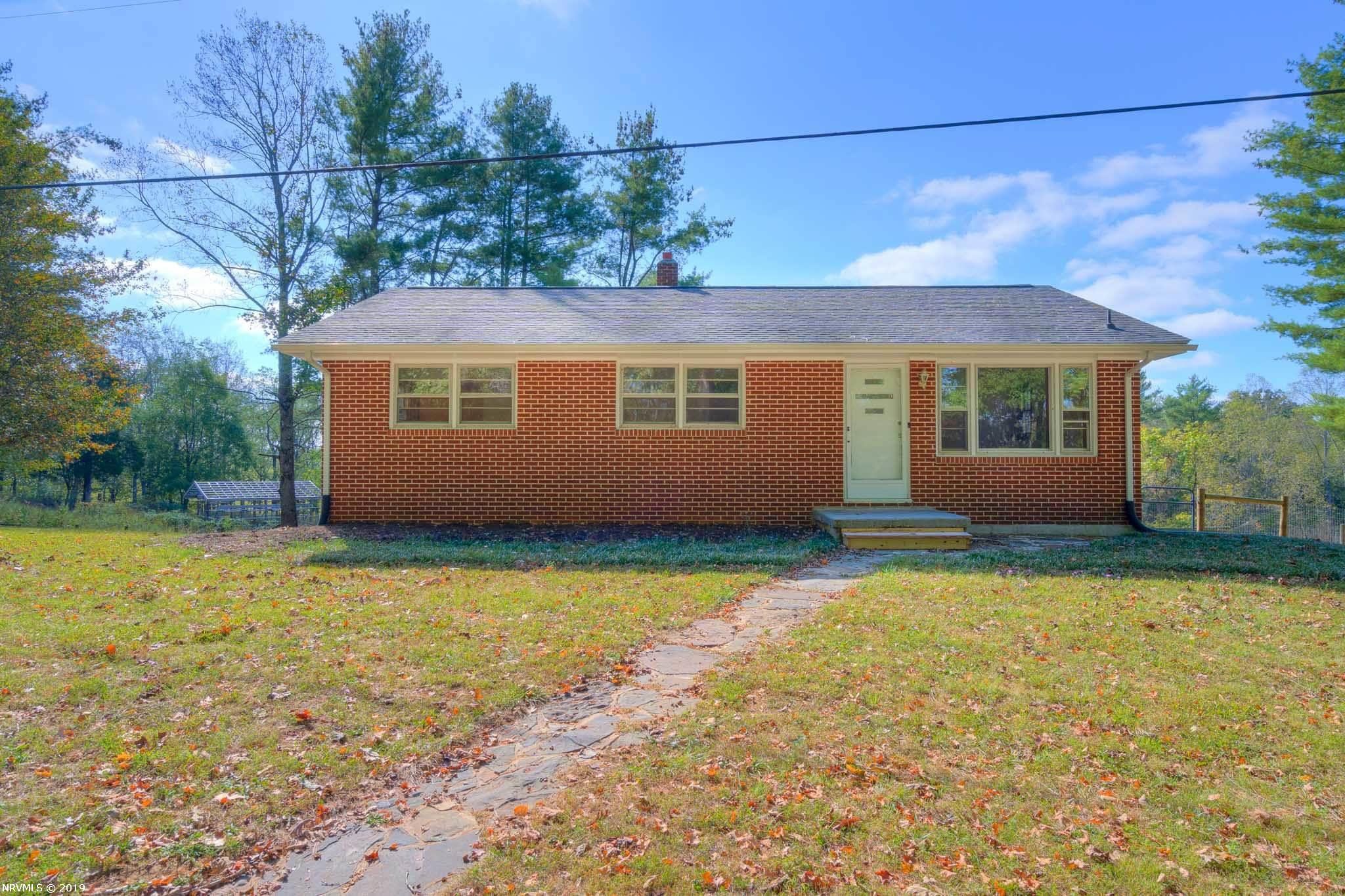 Charming 3BR/1BA home close to Town of Blacksburg, the New River and Jefferson National Forest.  Interior features include refinished hardwood floors in living room, hallway and all 3 bedrooms, eat-in kitchen equipped with all appliances (range/oven, dishwasher, refrigerator), full unfinished walk-out basement with laundry room, workshop space and plumbed for an additional bathroom.  This cozy brick cottage rests on a nice 1 acre lot adjacent to nice meadow and offers a spacious deck, outdoor kitchen and ample gardening space.  Affordable opportunity for a Blacksburg home with some space between neighboring homes.