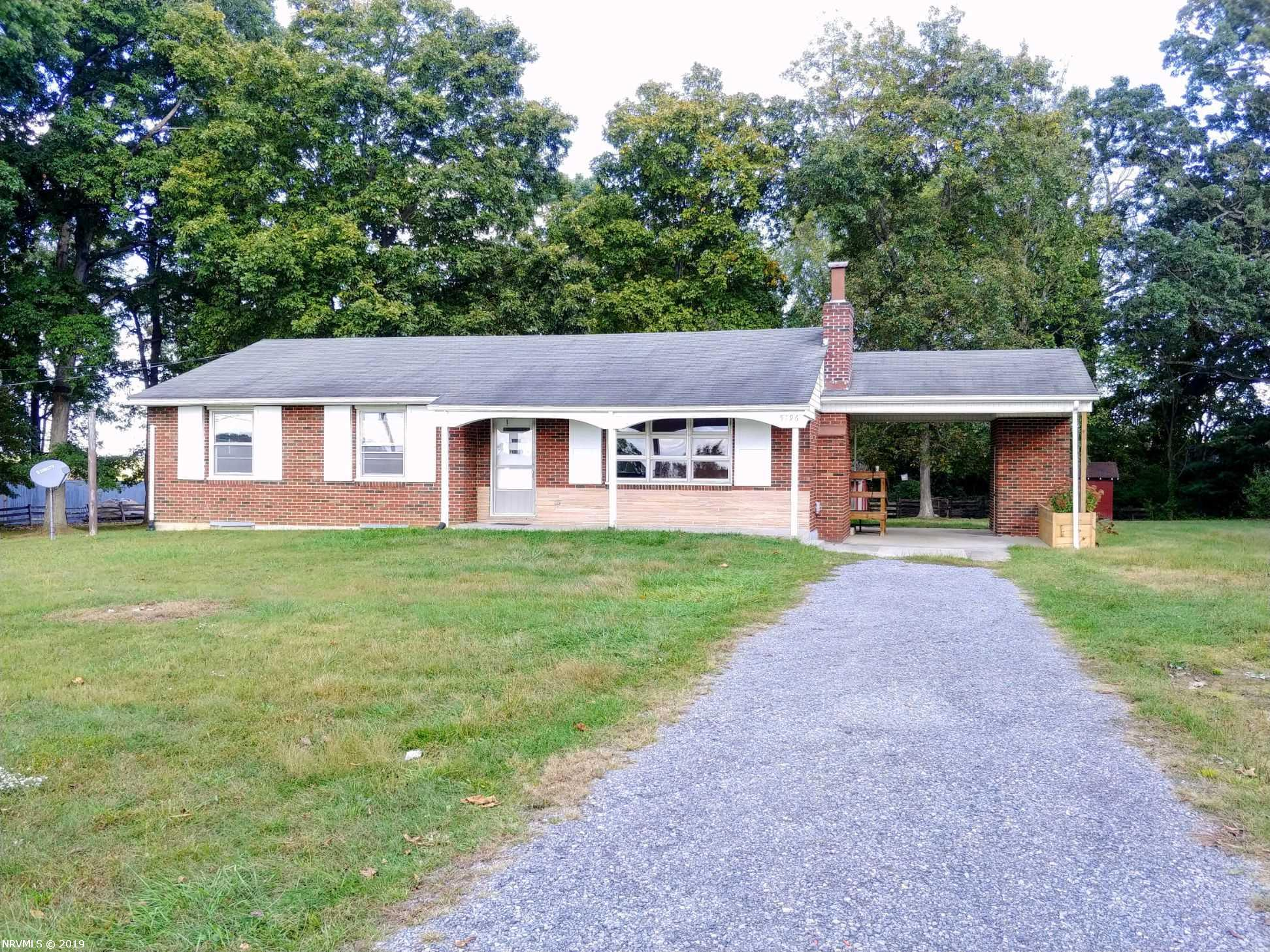 This home is located close to Claytor Lake on 1.15 acres.  The home offers 4 bedrooms one full bath with beautiful refinished hardwood floors.  You will enjoy keeping warm in your living room by the fireplace this winter.  This location is convenient to Radford University, Va. Tech, New River Community College only 2 minutes from I-81. Come take a look at all the amenities the home offers storage under the carport and pizza oven, garage-work shop and out building.  Part of the basement is unfinished and has lots of storage with  shelves  and possible work shop area also the other side could be turned into a rental or mother-in law suite with bedroom, kitchenette area and outside access.