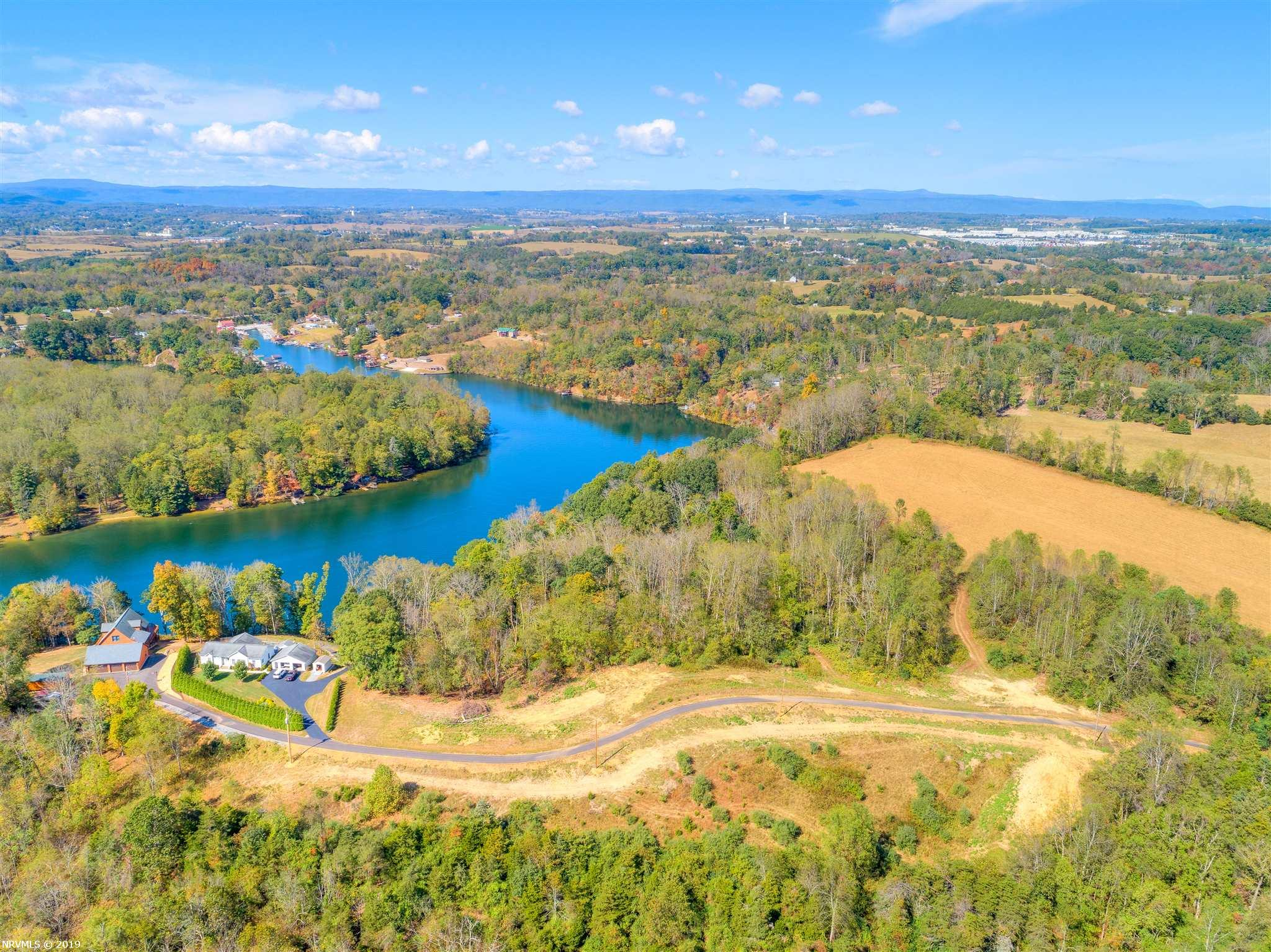 A true rare find on the shores of Claytor Lake! Build your lake get-a-way or full time residence on this amazing waterfront lot serviced by a newly paved private road. Convenient to I-81, Volvo, shopping and much more! Sellers to provide a new survey with perc test to accommodate your future plans. Call today for more information and your private showing. Some deed restrictions apply.