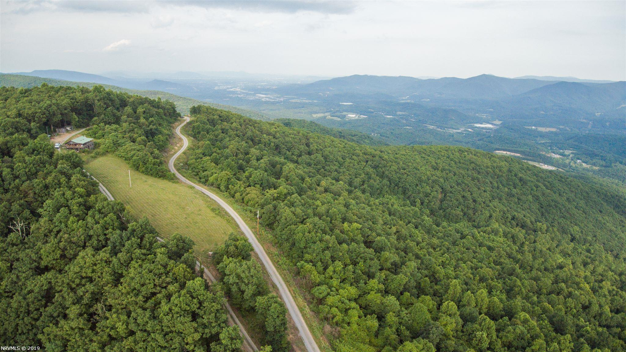 Gorgeous mountain top retreat conveniently located between Blacksburg and Roanoke. Ideal recreation or hunting property. Miles of roads and ATV trails with breathtaking views.
