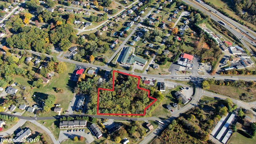 Two parcels of land zoned general business, very close to I-81. Property goes all the way from busy Main St to College St.  Great investment opportunity!  Property contains an 1186 square-foot bungalow which has been unoccupied for some time. Home is in poor condition and contains  2 bedrooms and 1 full bath with oil heat.