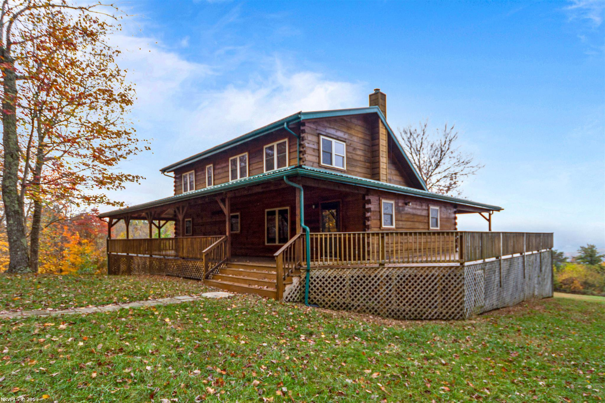 Nothing else in the New River Valley compares to this impressive 17 Room Log Home on 88 Acres! This home built in 2008 by the owner is a culmination of A Custom Built Amish Log Home to fit the historic and natural aspects of its surroundings. This totally 'off the grid' home w/Privacy is located midway in the New River Valley. Its architectural features include Exposed Beams, Cathedral Ceilings, Custom Cabinets & Door Handles & 4 Sided Decks to enjoy the Majestic Mountain Views! The total under roof square footage is 3,754 square feet. There are 4 bedrooms, 3.5 Baths  arranged around a massive great room with huge kitchen w/expansive Wood counters, Center Island,Gas Range, Ref, DW & MW. No problem if electric goes off - Outdoor Wood Furnace connected to Heat Plus Wood Stove in Living Room. Zoned agricultural for Livestock - Horses, Etc. Barn Shed of 27.2 x 25.08 w/Storage Room 25.08 x 12.75- Floored, 2 Windows & Hole for Flue.Like Decks? -1900+ SF of 4 sided Decks-covered & open.