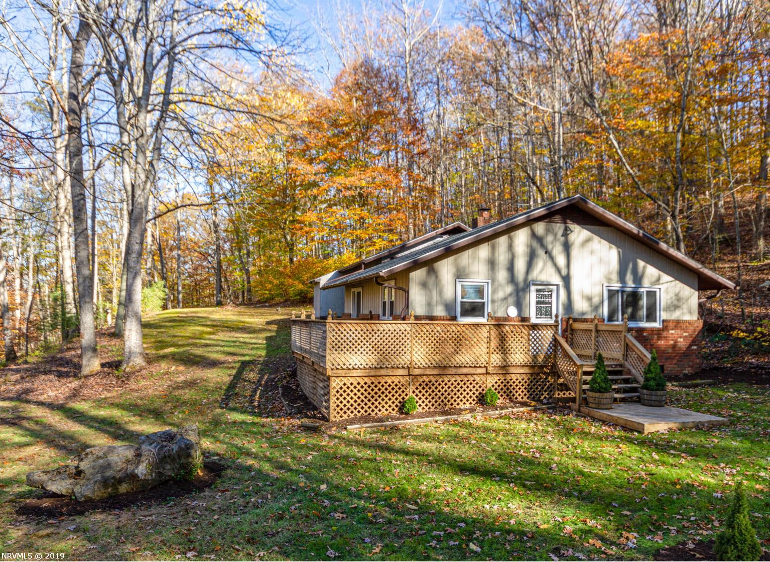 Beautifully remodeled cottage only 10 minutes from Blacksburg on 4 acres. Recently remodeled throughout with new appliances, bathrooms and freshly painted. Stunning stone fireplace, large rooms and gorgeous kitchen! New roof in April 2019, water heater in 2017, septic pumped in 2017, heat pump approximately 8 years old.