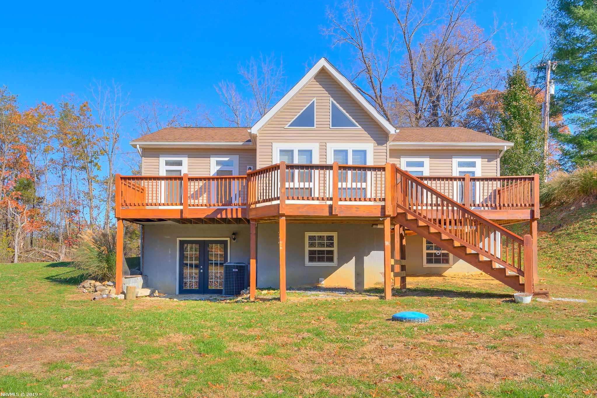 Beautiful home with Claytor Lake views! Built in 2005, this home has an open floor plan with vaulted ceilings and exposed beams. The split bedroom design offers privacy with the master suite on one side and the additional bedrooms on the other. Light and airy, this home has wide-plank hardwood flooring throughout, a spacious open kitchen and a main level laundry. If you need more space, the walk-out basement is ready to be finished with your touches. Enjoy the views of Claytor Lake from your spacious rear deck and large back yard! With a paved, private road to your front door and only 3 minutes to I-81 and Claytor Lake State Park, this home is so convenient to most everything. Call today for your private showing!