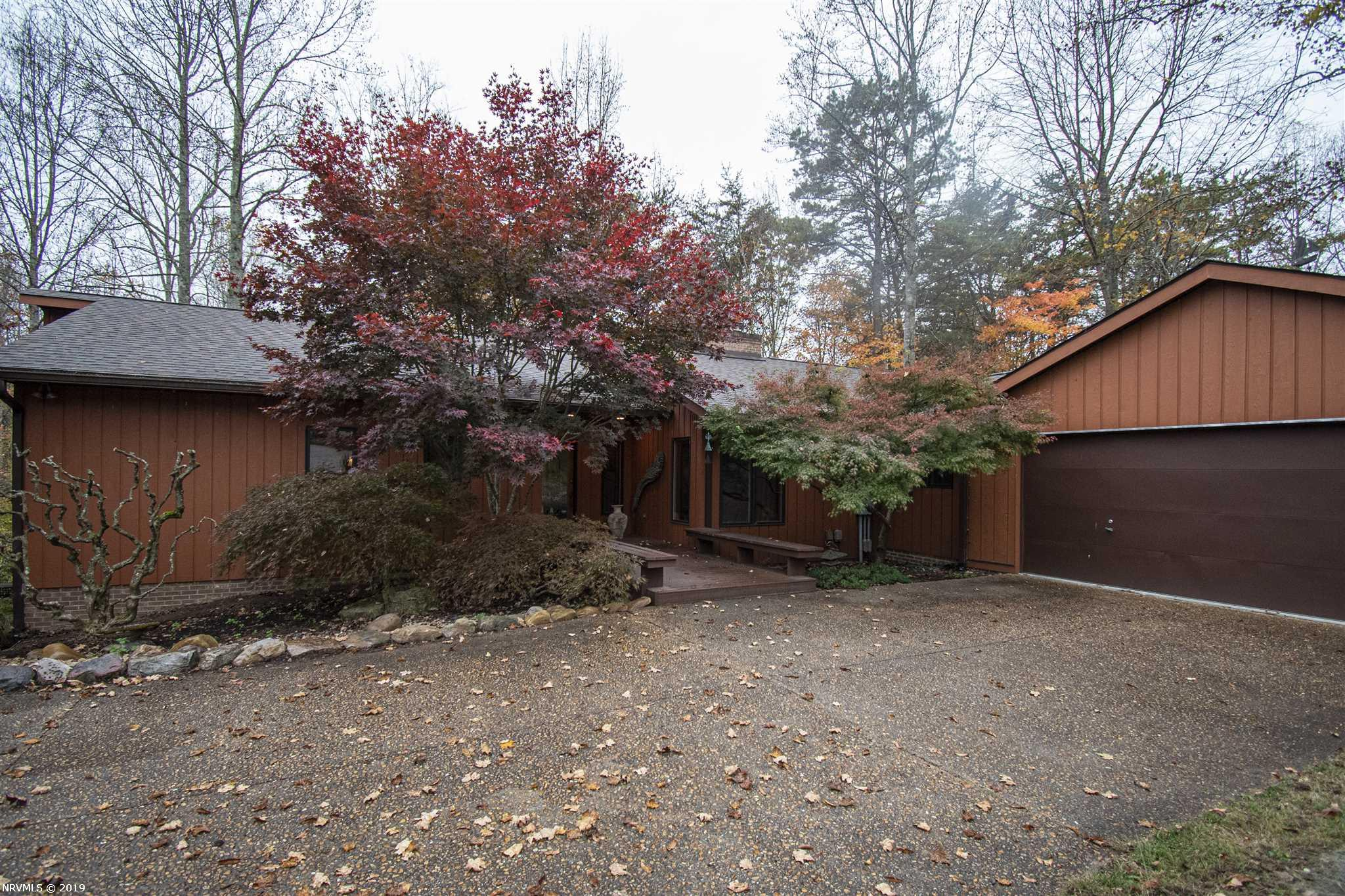 Contemporary style home on over 5 acres.  2 parcels.