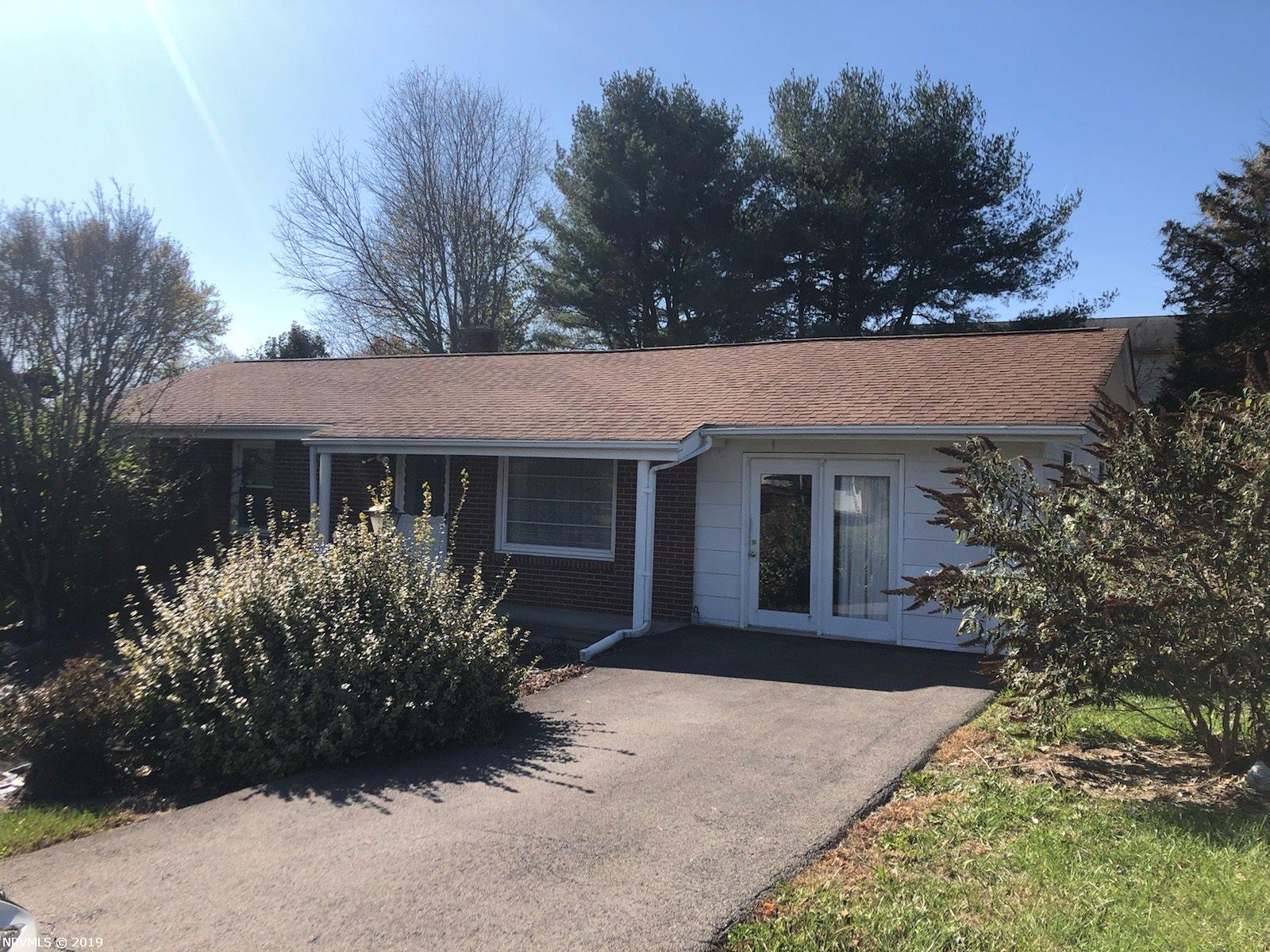 Brick ranch with full unfinished basement. hardwood floors throughout the main living area. Replacement windows except in the family room, newer bathroom cabinet, and storage building. Metal carport is also on this property.  Additional lot conveys wit heh is property.