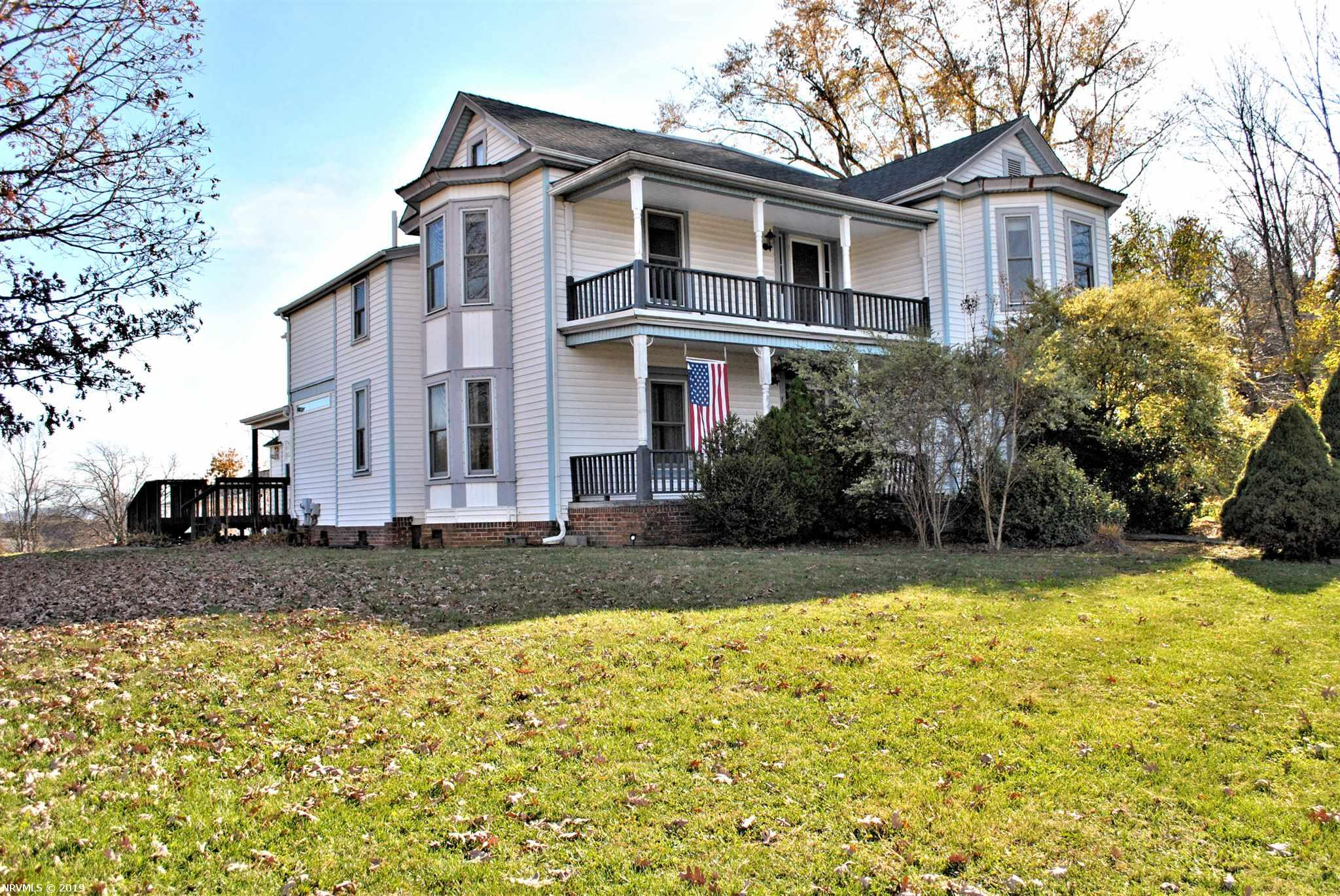 A magnificent home built to last with up to five bedrooms, three full and two half baths and a fourth full bathroom in the four car garage all on 2.74 acres. Choose between the MBR on the main level or upstairs, both with bay windows. Enjoy your morning on the sunporch which leads to a deck and hot tub and serve dinners in the formal dining room complete with a wet bar. Set up your Christmas tree in the bay window of the front living room with a gas log FP framed in by a gorgeous mantel and the grand staircase will take you to a large hallway leading to the balcony with long range views of Walker Mountain in Giles Co. Two of the upstairs BRs share a Jack & Jill BA with corner shower and there are rooms for storage, an office and den with a second staircase leading back down to the kitchen. The heated garage has a finished area which includes a full bathroom that has the potential to become a small apartment. This home has been lovingly updated through the years and awaits new memories.