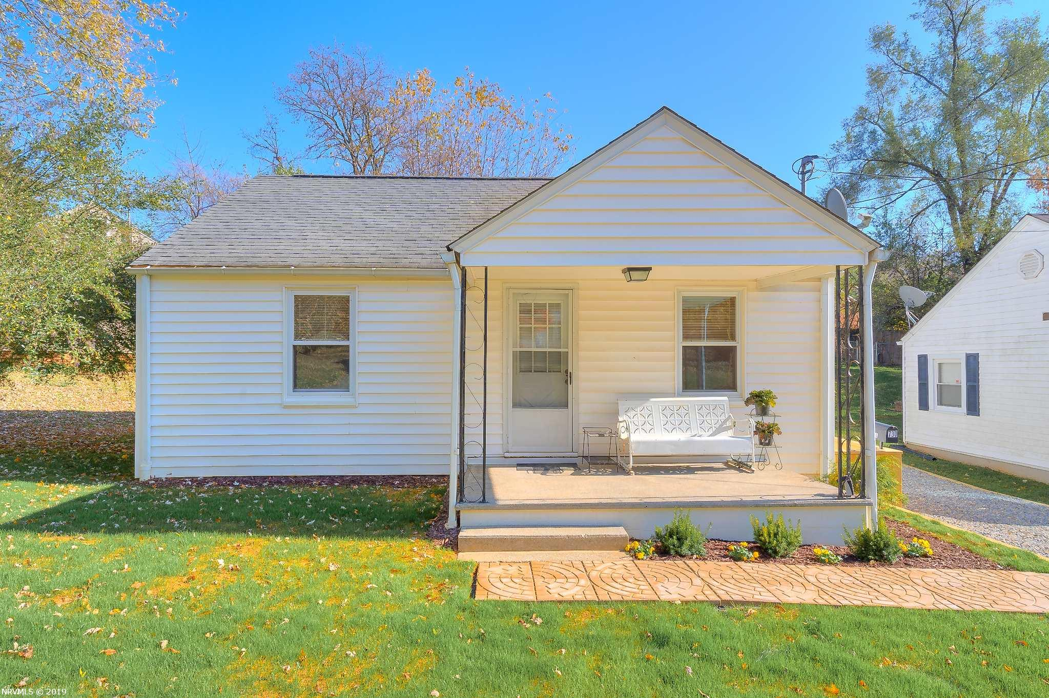 The cute cottage is a wonderful starter or retirement space, and is move in ready! Fresh paint and polished hardwoods throughout. Updated bathroom. Insulated replacement windows. New HVAC. Newer appliances, including a brand new refrigerator. Washer and Dryer on the main level on a sunny, fully enclosed back sun porch. Brand new graveled drive and landscaping. The large covered front porch is the perfect place for relaxing with friends and neighbors! Cozy living room and bedrooms are all bright with lots of natural light, hardwood floors, and fresh paint. The kitchen is roomy for this size cottage, and you will definitely enjoy the sunny, fully enclosed back porch.  The basement has outside access, with brand new steps.  It is dry, has tons of storage space, and plenty of room for workspace too!  This home has been prepped for new owners with great care- a must see!!