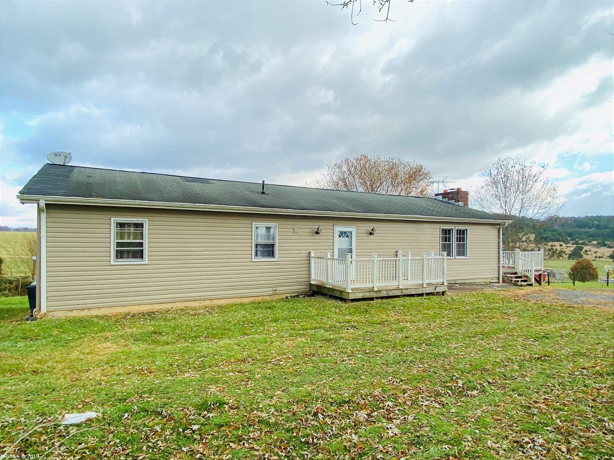 Lovely updated 3 bedroom 2 bath ranch. This home sits on 1.13 acres with lots of privacy. Gorgeous rustic kitchen with custom cabinets and granite counter tops. Just a few personal touches and updates to this home to make it all yours. Large detached garage with lots of storage space! Make plans to see this home today.