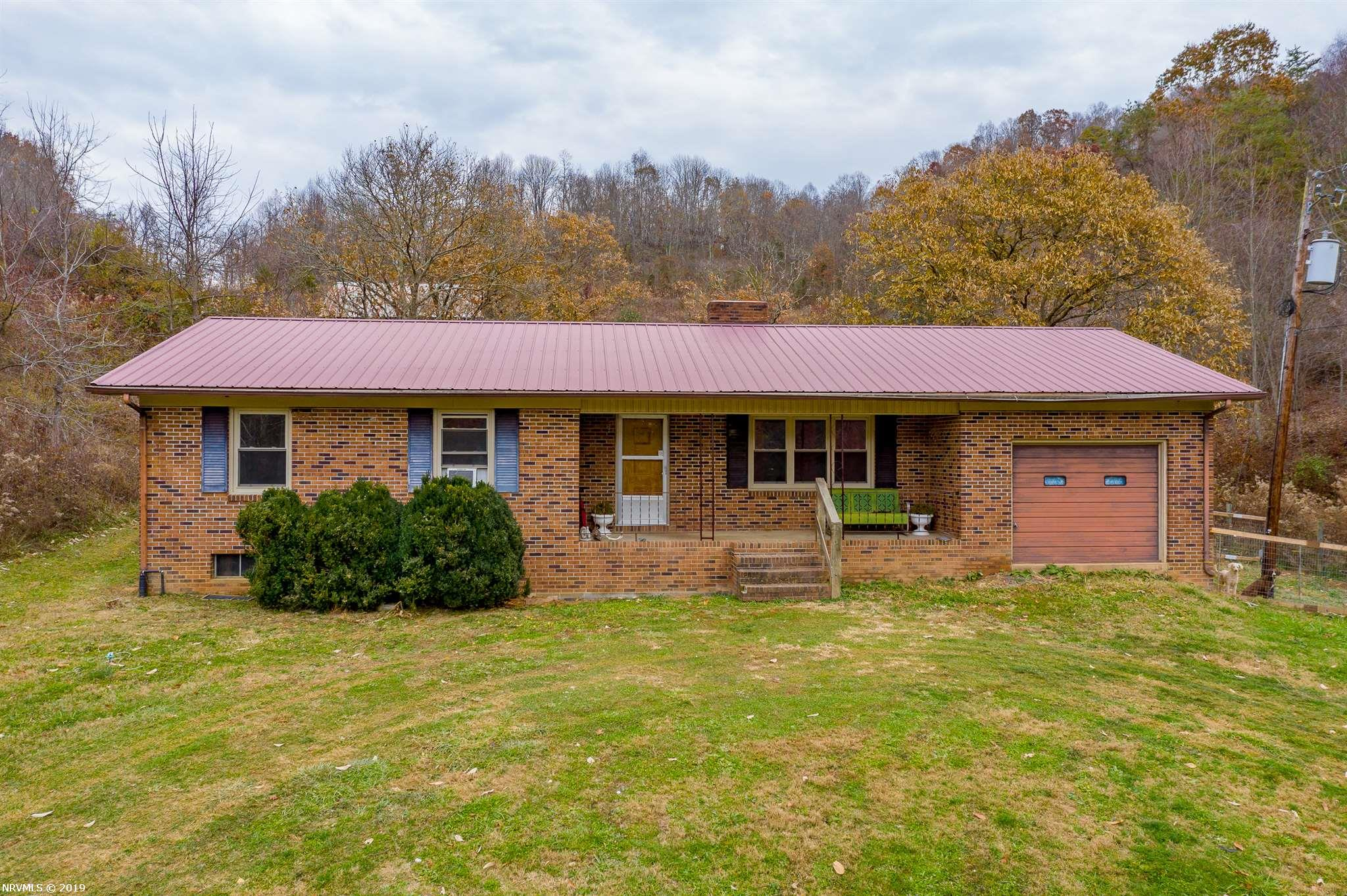 This remarkable property is ready to be both a home and an outdoor playground! This 3 bed 2 bath home sits off the road on secluded 112.74 acres. A classic brick home includes a fireplace, full basement, and a finished garage. Multiple outbuildings are perfect for your workshop or ATVs and other outdoor toys. Large trees and trails running through the property provide a beautiful, quiet place to ride, hike, and explore. Don't miss out on everything this home has to offer. Schedule a showing today!