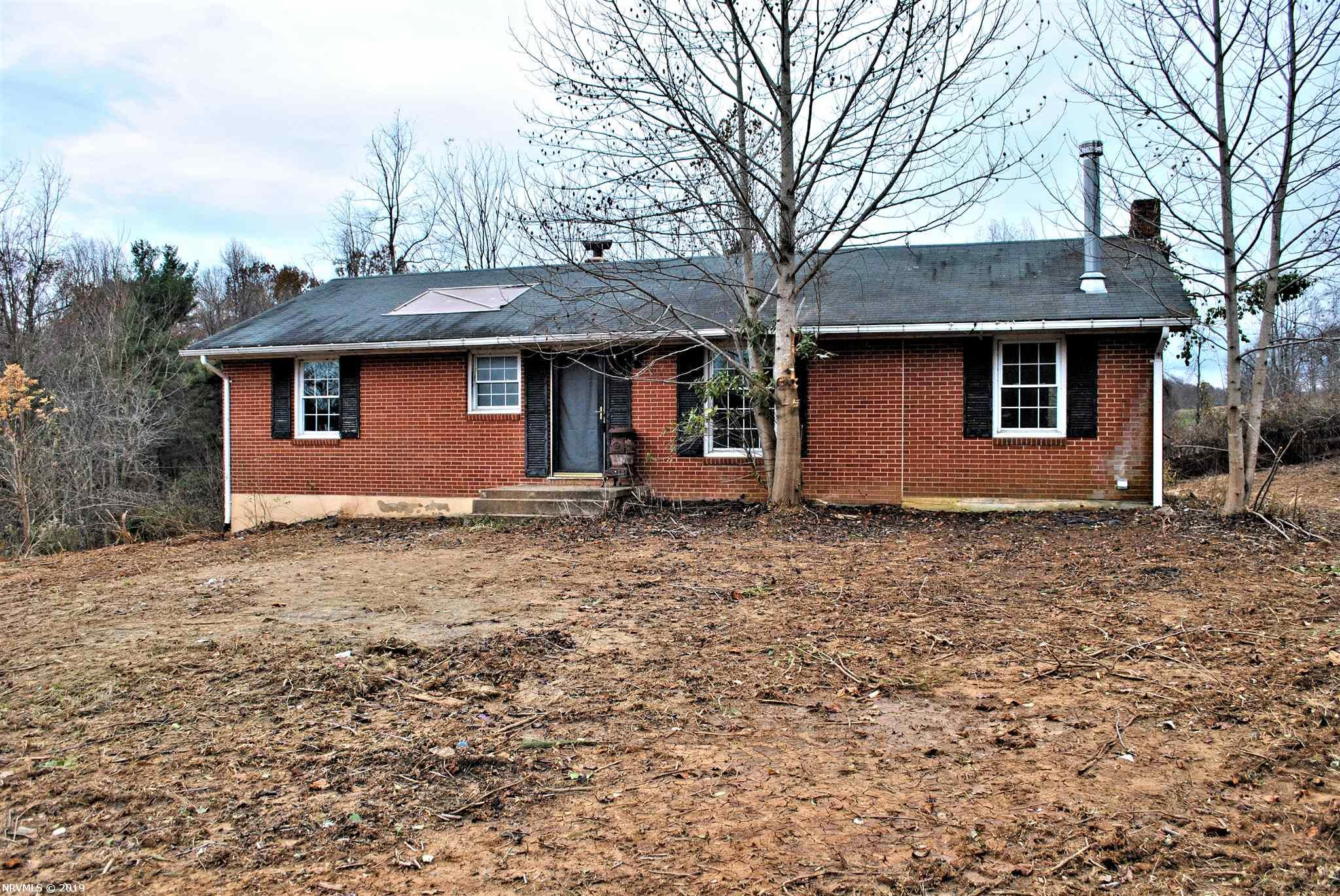 Country living on this 7.5 acres with a 2BR, 1BA brick ranch with room to expand in the building over a three-stall barn. Walk-out basement is unfinished and ready for your updates.