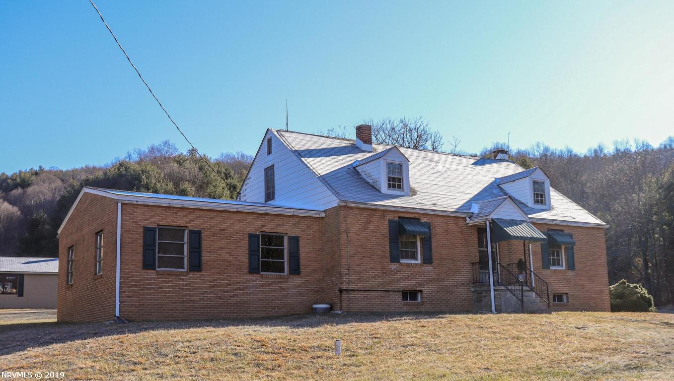 Sweet country home out in the Willis area of Floyd County VA. This home features a beautiful recently remodeled kitchen, hardwood flooring, 3 bedrooms and a gorgeous full bath on the main level. Upstairs you will find a large loft area for storage or whatever you desire. This home has a large sunroom attached on the back side, perfect to sit and hangout with your loved ones on quiet evenings.  Out back, there is a large concrete building which can be used as an extra garage, workshop or just for storage!  Pretty flat yard for kids to play or dogs to roam and a small stream out front between the home & the road.  This home is perfect for a first time home buyer, small family or someone looking to retire out to a peaceful home in the country.