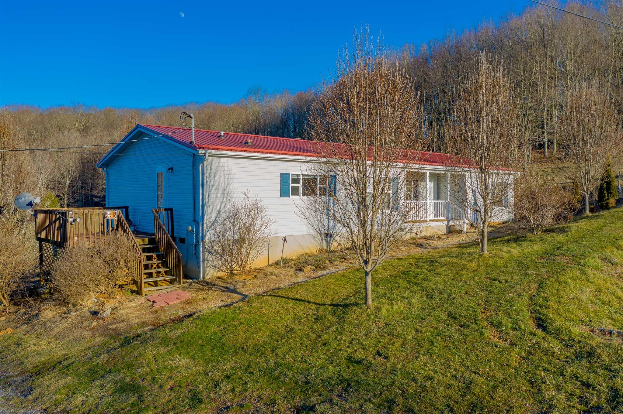 Looking for a view on a budget? Checkout the beautiful scenery from the back deck of your porch, while still being two miles from I-77, just minutes from the town of Bland, and 20 minutes to the town of Wytheville. With 1515 square feet, 3 bedrooms, 2 baths, and spacious open floor plan, as well as a roomy master suite with his and hers vanity, there's enough room for all of your needs. Less than 14 years old, enjoy low maintenance living with a heat pump to keep you cool through the sunny summers, and warm during the beautiful winters, with a corner fireplace to cozy up next to. See what not just this property but the rural living has to offer with National Forest and recreational opportunities just minutes away. With all appliances included, and the possibility to purchase fully furnished, this home is truly move in ready. Schedule your private showing today and see what all this nearly 2 acre property has to offer! Current owner loves the home and area, but is needing to relocate.