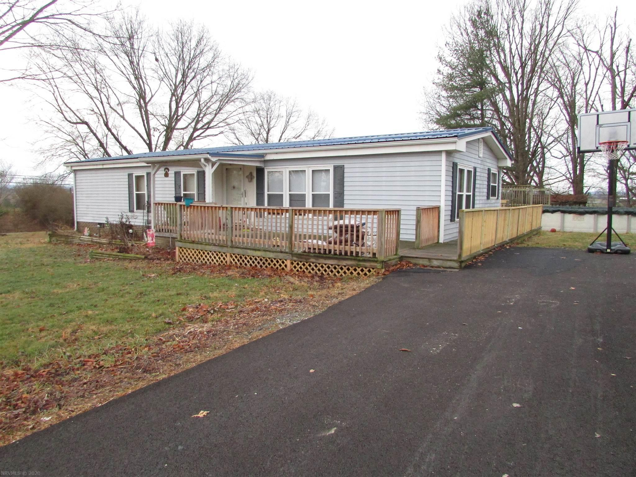 3 bedrooms, 2 bath Double Wide out in the county yet still close to Dublin or Radford.  Nice wrap around deck, paved driveway, large yard  24 x 28 detached garage. Above ground 27 ft. pool with decking.  Heat pump less than 5 years old, roof age 4 yrs., gutter is new, plumbing less than 1 yr old,.   Custom Cabinets