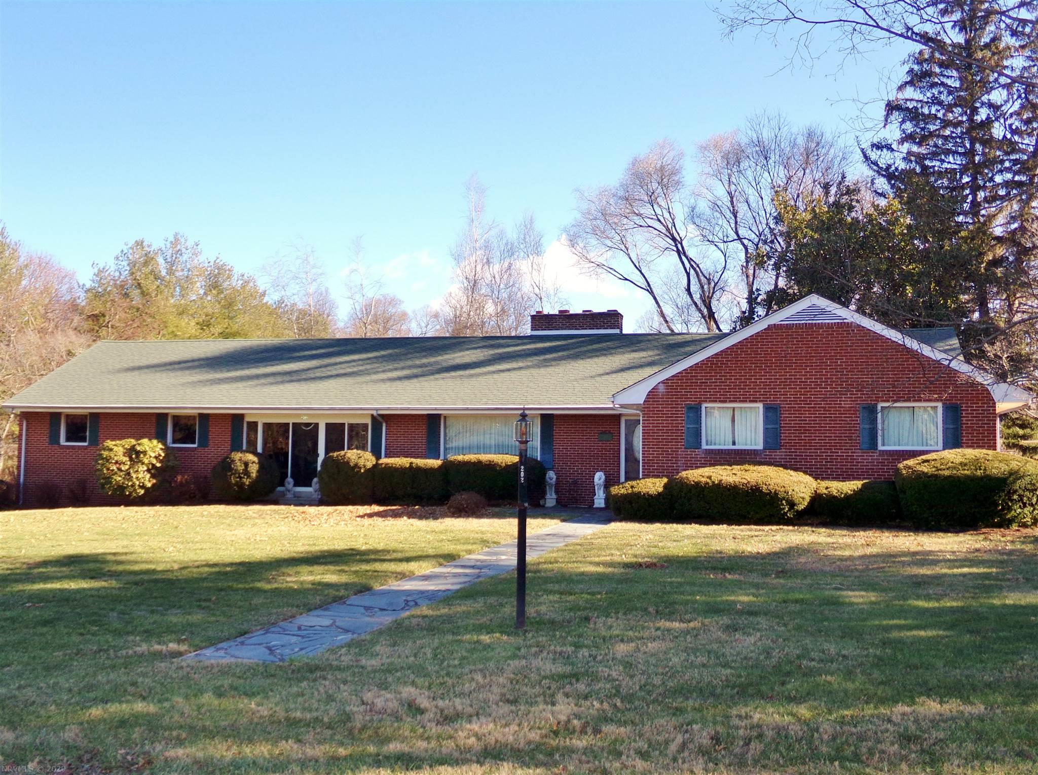 Spacious Brick Ranch w/level yard. Great location! Lovely hardwood floors. Three fireplaces. Recessed lighting. Heat Pump & Roof approx 4+/-  yrs old. Great Sun RM! Custom walnut paneling in some rooms. New main water line is being installed.