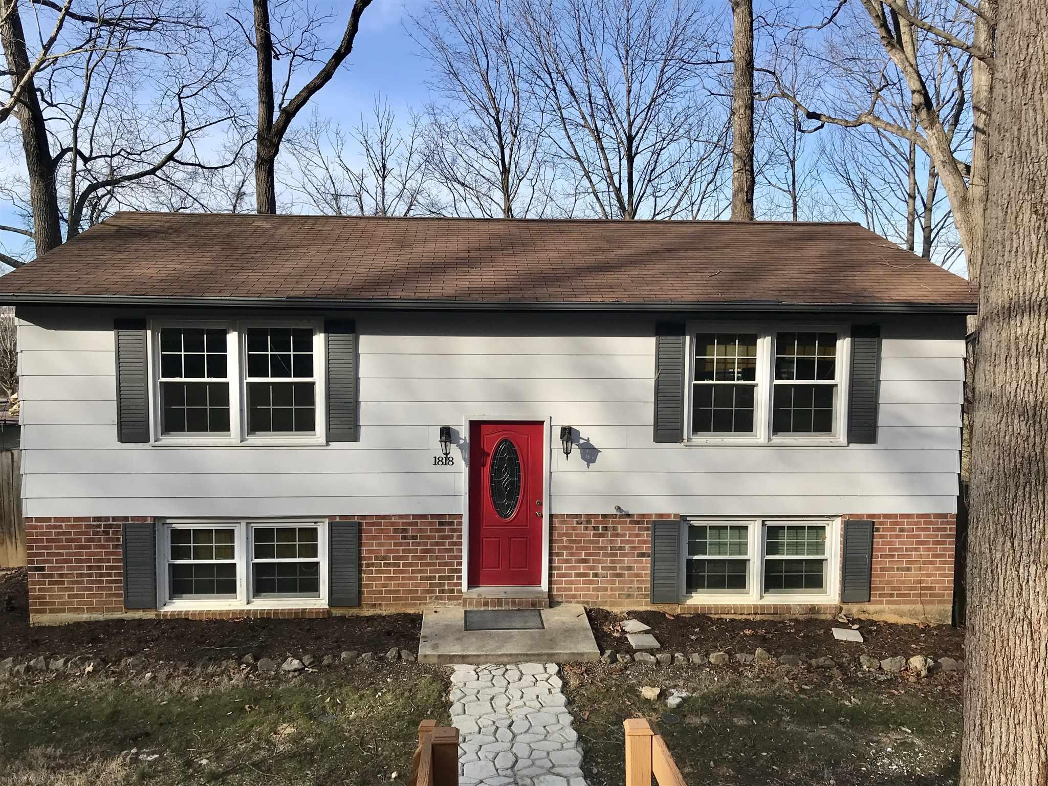 This 4BR/2BA Blacksburg home with a fenced-in backyard has two generous sized decks overlooking the flat backyard which over looks Nellie's Cave Park! Hardwood floors throughout main level and the white, bright and airy kitchen boasts stainless steel appliances. Both full bathrooms have lovely ceramic tile. Downstairs has laminate bamboo flooring and a walk out to the backyard. Replacement windows throughout.   New exterior paint.  Located in the quiet neighborhood of Crestwood Garden. Close to Virginia Tech, bus stop, South Main Kroger and Downtown Blacksburg.