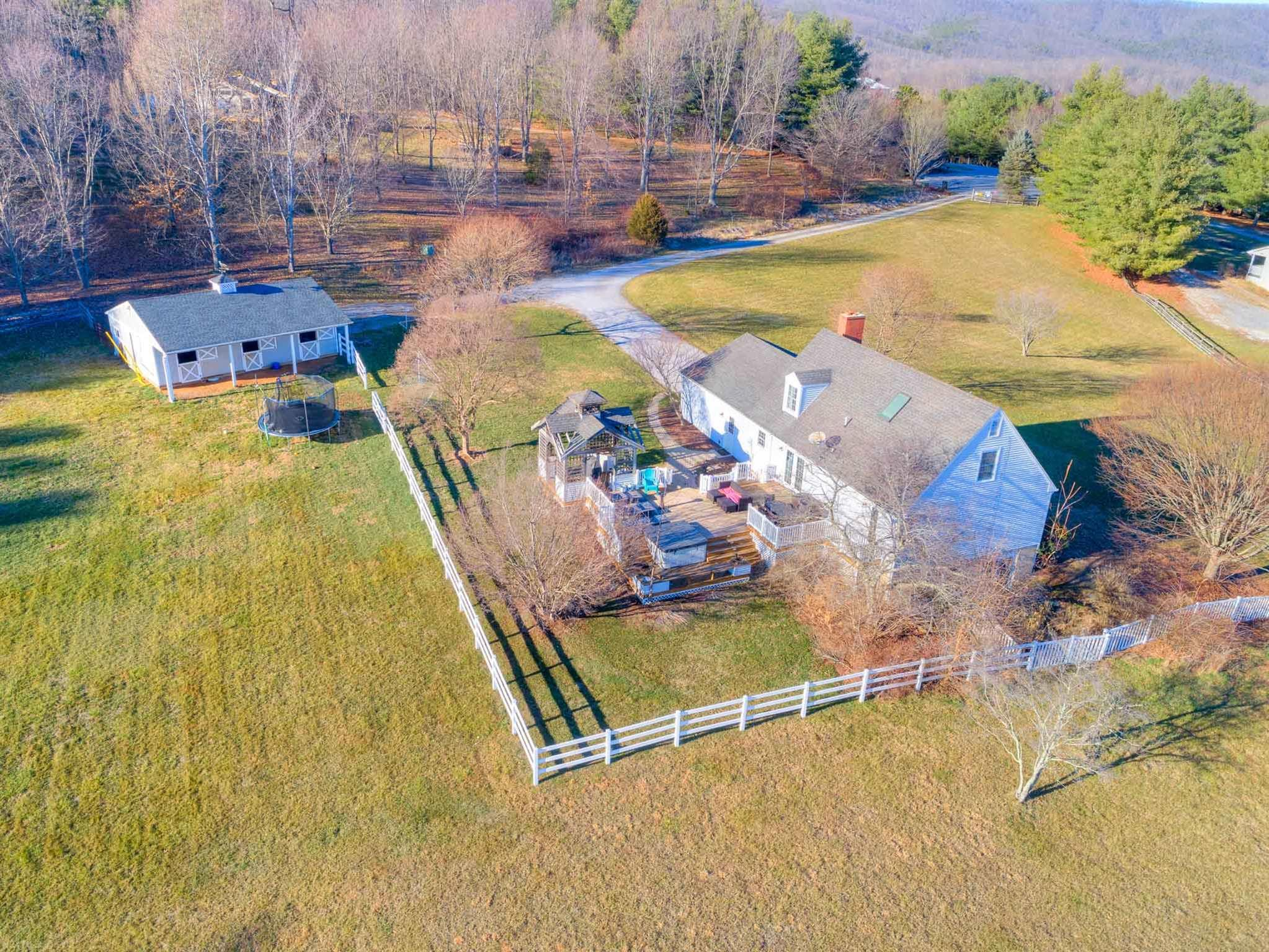 Updated cape cod on 4.7 acres with a 3 stall barn...only 2.5 miles to North Main Street in Blacksburg!  This property has so much to offer: beautiful views, fenced pasture, quiet cul-de-sac location, multi deck with hot tub to name a few!  The main level of the home includes a living room with a fireplace and beautiful custom mantle; eat in kitchen with solid surface counter tops, new appliances, double oven and slider to the deck; two generously sized bedrooms, an updated full bath and an oversized two car garage.  The entire upper level is a master suite with vaulted ceilings, skylights and walk-in closet.  The walk-out basement is plumbed for a 3rd bath and has a ton of potential to expand your living space.   A few add'l extras include a whole house water filter and a flue in basement for a woodstove.  The barn has a tack room, electric and water spigot for convenience.  Grocery shopping and access to the 460 by-pass are just a few miles away.  Get the rural feel minutes from town!