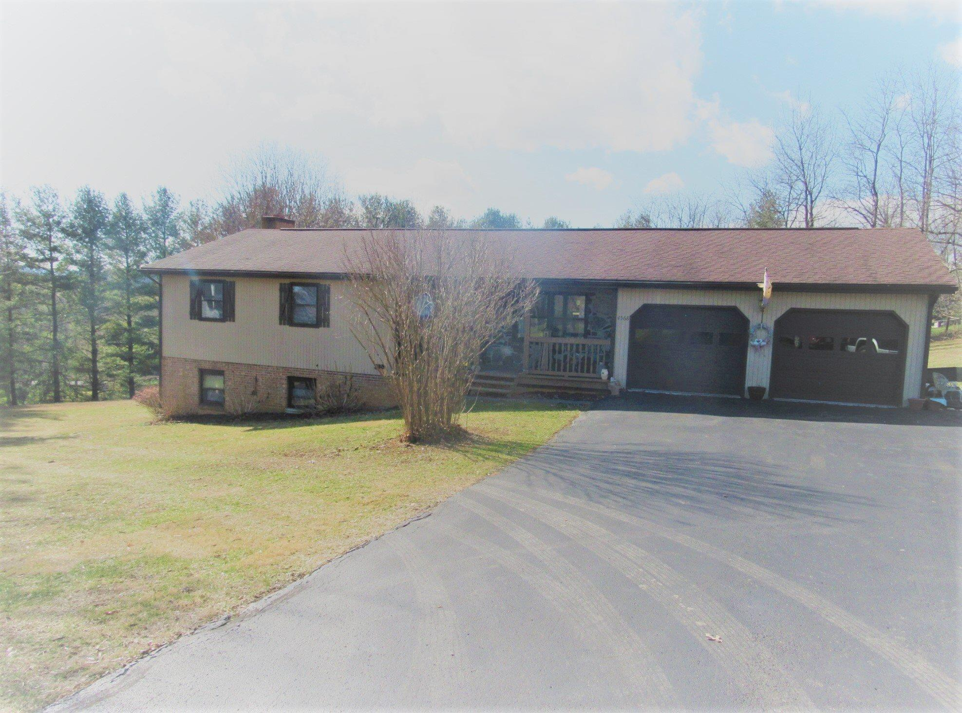 Beautifully Updated Large Brick Ranch home on nearly 2 Acre lot in the coveted Mountain View Subdivision! This home boasts 5 bedrooms and 3 baths, eat-in kitchen,formal dining/living room, full finished walk-out basement-rec room with tons of storage,den with stone fireplace amazing sunroom facing the mountains that is attached to large wood deck with built-in pergola over-looking this beautiful property! Home offers hardwood flooring, updated kitchen with stainless steel appliances and ceramic tile backsplash, updated bath with ceramic tile backsplash and ceramic tile flooring, brand new hot water heater, heat pump, skylight, wood-burning fireplace, covered patio with HUGE storage building, and 2 car attached garage with overhead attic storage. Definitely a MUST SEE!