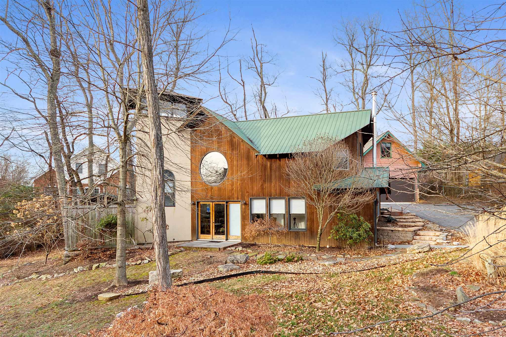 Stunning contemporary on a large lot just minutes from downtown. Enjoy the open floor plan, tons of natural light and hardwoods and tile floors through out. Any chef would be in heaven in the completely renovated gourmet kitchen outfitted with a Wolf induction / gas combo cooktop, built in Thermador fridge, marble counters and a beautiful Maple bar top. Keep your feet warm while you cook with the heated tile floors. On the main floor is the master suite with a wood burning stove and an impressive master bath with dual sinks, granite, a towel warmer and custom dual head shower. Upstairs you will find the other two bedrooms and a large bathroom with a claw foot tub. The entire yard has been thoughtfully landscaped. Plenty of storage above the garage.