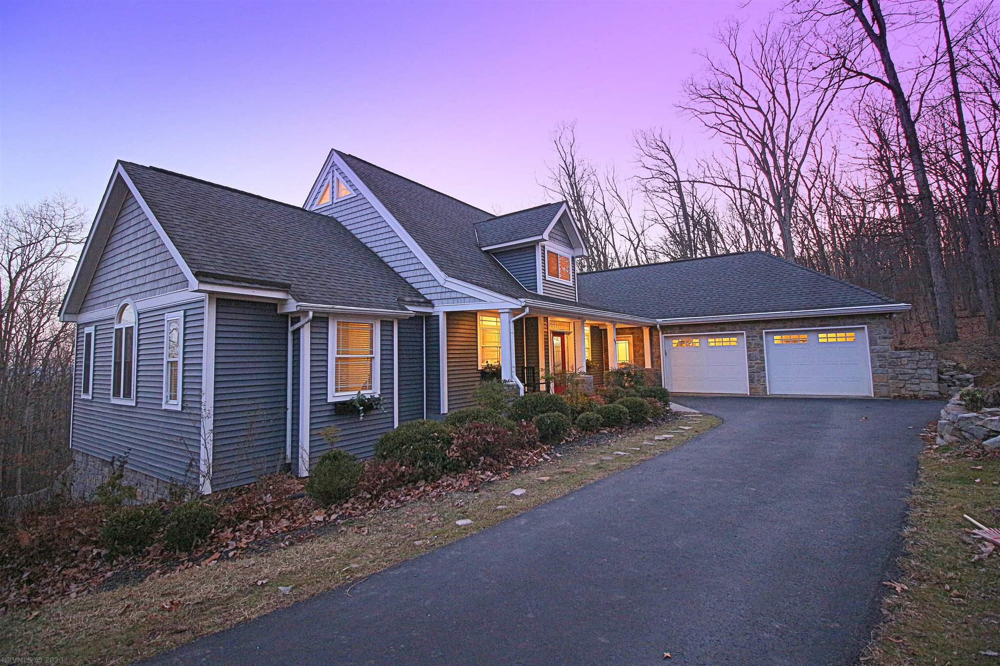 Welcome to a home that achieves the desired connection between escape to the outdoors with modern living. Only minutes to Virginia Tech, this spectacular home on 4.4 acres has a contemporary design. Cathedral ceilings adorned by exposed beams and open concept kitchen with an island. French doors open to a vast deck, and oversized windows reveal spectacular views of the sunsets, starry nights, and surrounding mountains. Carefully designed for luxury living, this contemporary craftsman has three bedrooms, the garage, and laundry on the entry level. The master suite has vaulted ceilings with a walk-in closet. Upstairs is an exciting and expansive loft space, ideal for a home office, studio, or playroom. The lower level has a bedroom, full bath and kitchenette.