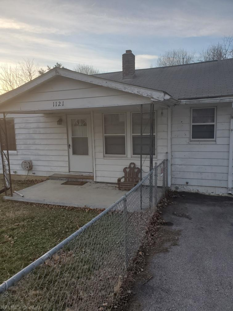 Nice home, with great potential. Sold As-Is. This home sits on 2 lots and is fenced in. 2BR, 1BA. Custom cabinets and a full, unfinished walkout basement.
