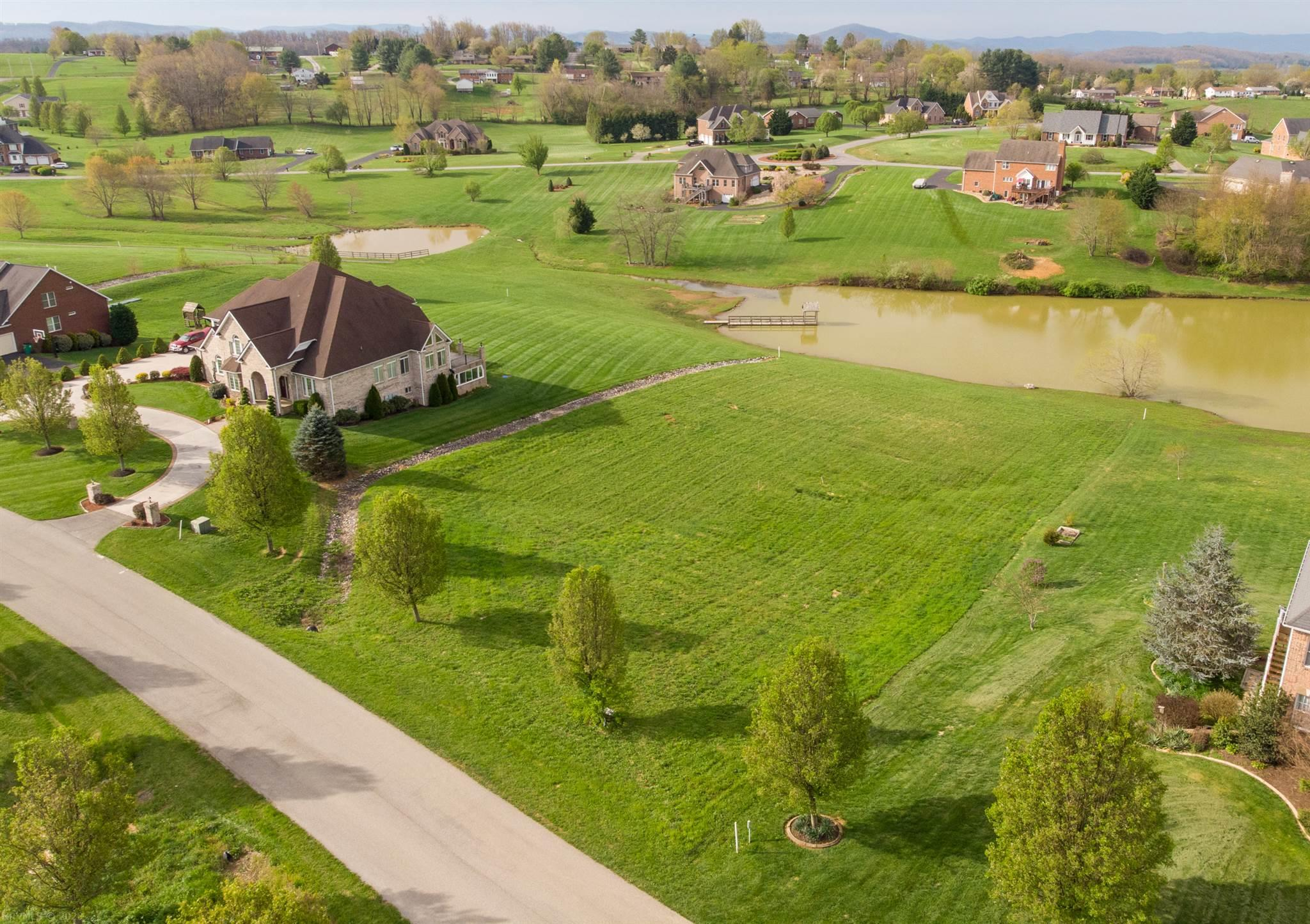 Build your dream home on this beautiful 1+ acre lot in highly sought after Heritage Place! This is the last remaining lot with waterfront access, which also boasts outstanding views of the rolling hills and of the community lake. Town water is available and septic work on file. Don't miss your chance to call this prestigious neighborhood your home!  Seller is also a builder in case buyer is interested in having a gorgeous home built by GSC Custom Builders, LLC!