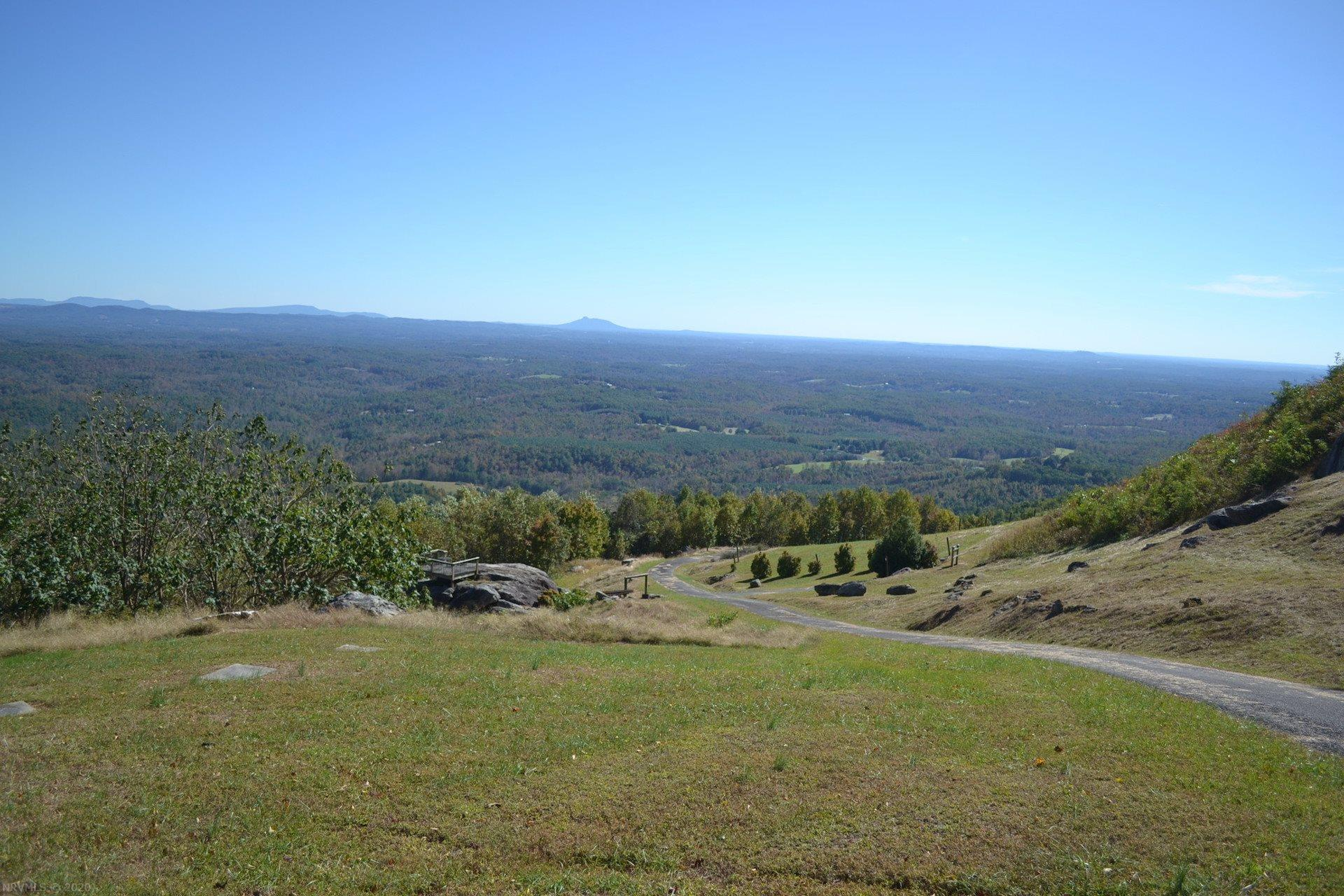 If you've ever wanted that million dollar view, you can find it right here! Build your mountain dream home here and you can own the 20+ mile view across the valley to the distinct peak of Pilot Mountain. This offering includes 18+ acres, a paved drive, a small stream, a spring and small pond, a stone brick oven, two elevated platforms for camping, entertaining, and taking in the views, and a shelter that is ready for two bathrooms to be tied to your new water system. With room to stretch your wings, the spring, and the view, this property is a rare opportunity indeed. Call for your appointment today.