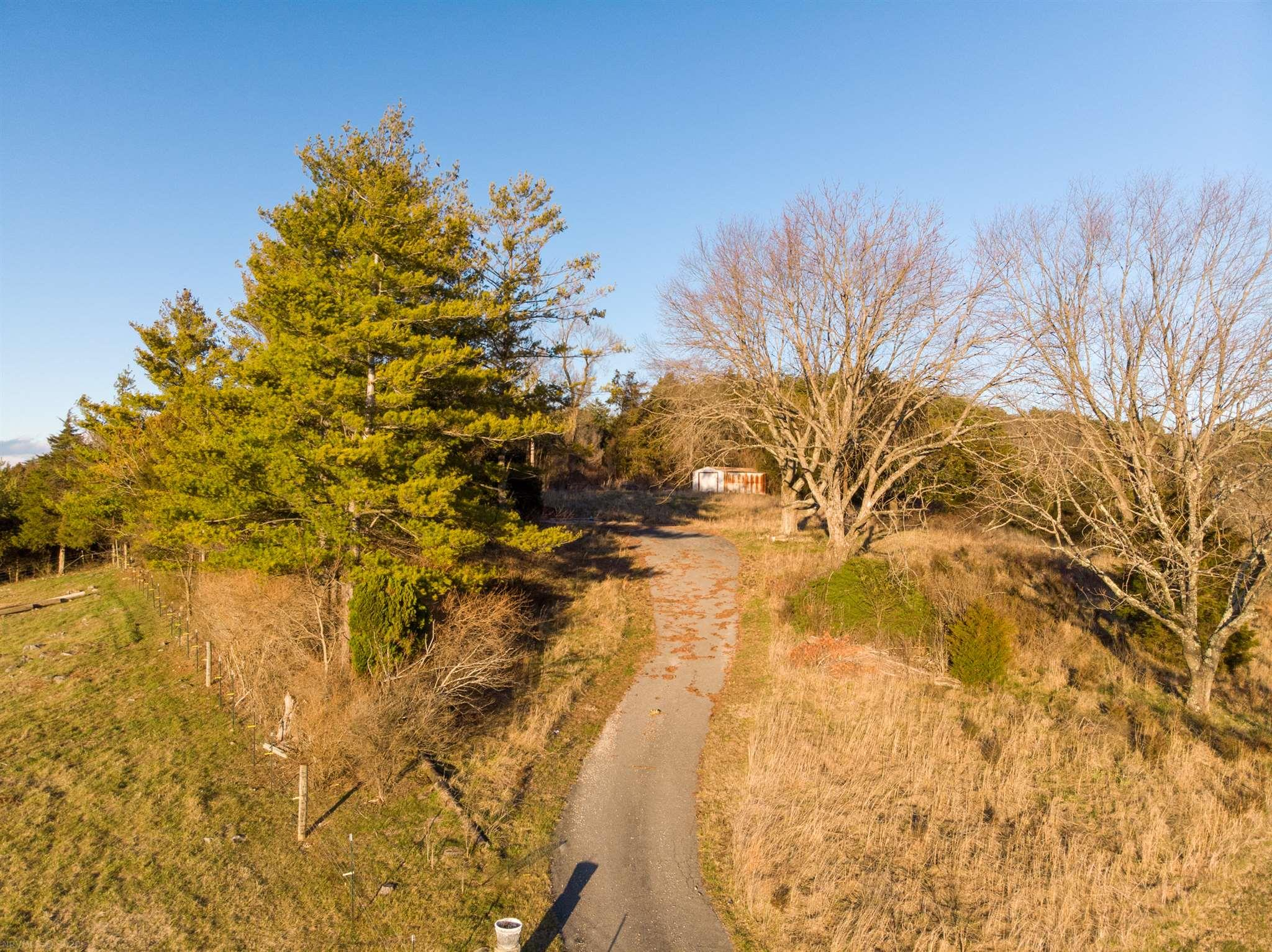 Amazing, majestic views await on this peaceful 1.5+ acres overlooking the area with paved driveway and septic. This property is located close to many amenities yet has a rural charm to it. Build your dream home on this lovely parcel of land.