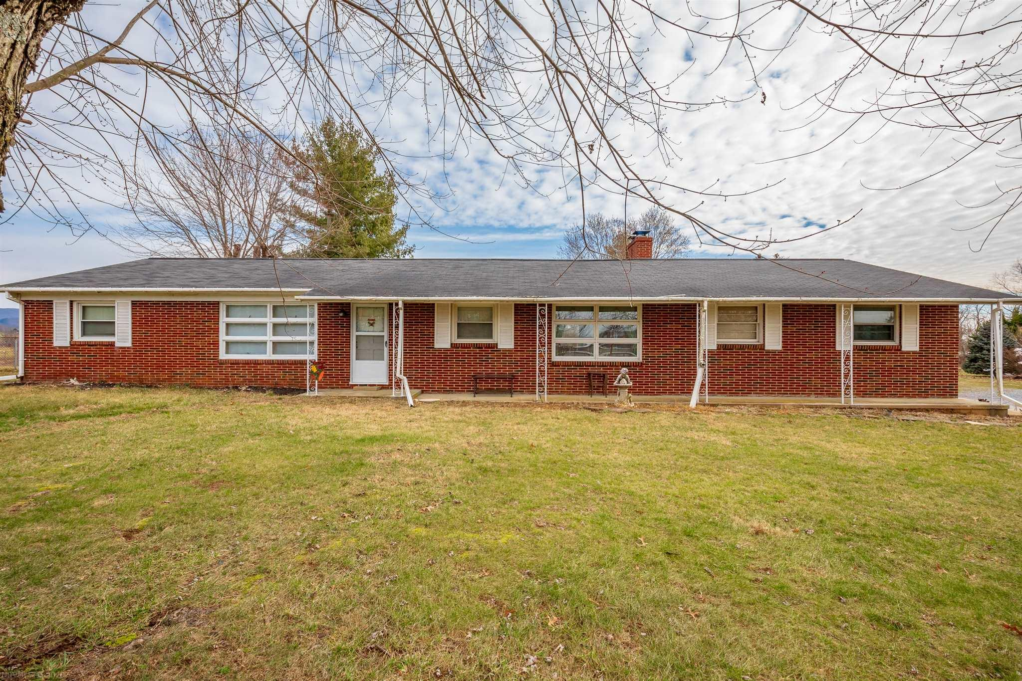 Country living in town limits! If one level living is what you desire then this home is a must see! Well maintained brick ranch offering 3 bedrooms, 2 baths, and an unfinished basement that gives you the option of more living space in the future. The family room hosts a built in grill and wood stove with plenty of room to host friends and family. This property offers a level 1.9 acres of possibilities such as garden space or room for additional structures. Mature apple trees, grape vines, and visits from deer and other wildlife right outside your back door. Literally minutes to I-81, an hour drive to Bristol and Roanoke and a short distance too many local attractions. You must see to appreciate so schedule a showing today!