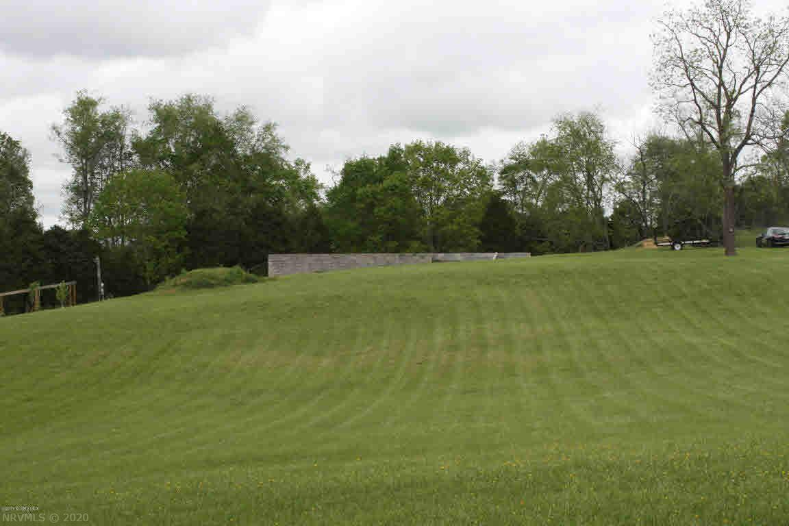 This property offers a great opportunity for someone wanting a few acres. You can custom build or have modular home placed. Land lays very nicely with a 2264 square foot block foundation. Well and 3 bedroom septic already in place. Fruits trees and grapevines and beautiful pastoral setting. Great convenience to I-81 and Claytor Lake area