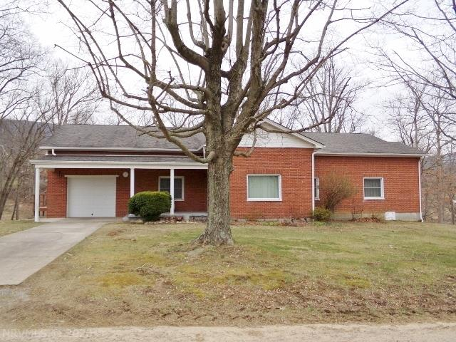 Spacious Brick Home on approx 1.2 acres. Great view! Beautiful hardwood floors. Large Bedrooms. Nice Family RM w/fireplace/wood stove insert & built-in bookshelves. Enclosed porch. Front porch. Side deck. Insulated windows. Updated guttering.