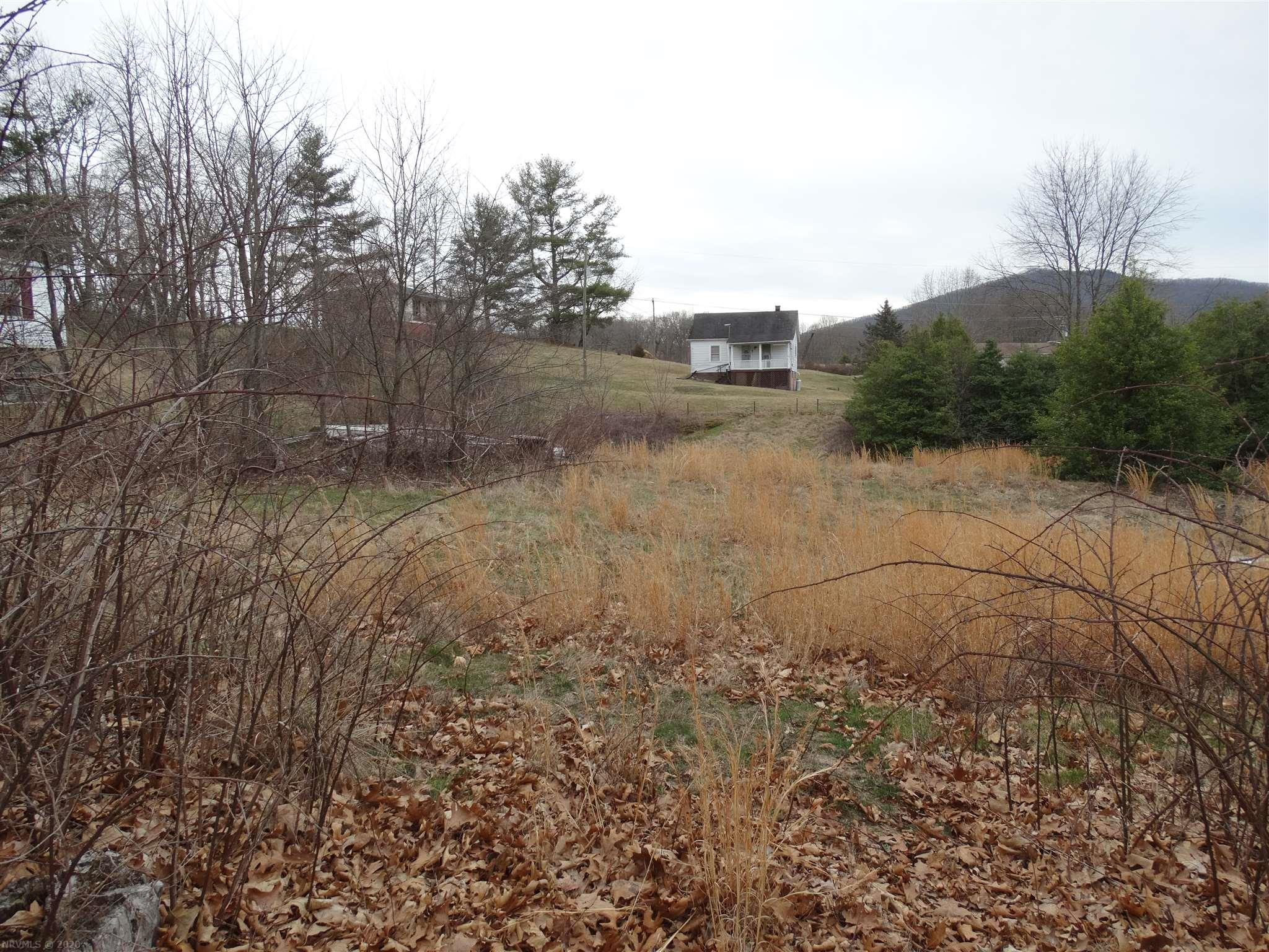 PRICE REDUCED !!                                                                 $13,475/LOT with 2 LOTS BEING SOLD FOR $26,950. Possible to build home or put DWMH on each lot. Public water & public sewer at the street.  Lot 22 on left has deeded access with 20' Alley as on Survey. Lot 23 has deeded access with 30' unimproved road on right per survey. Seller will remove lumber on Lot 23 if Buyer desires or buyer may have lumber. See documents & especially survey for details.  Lots - mainly cleared. Less than 3 minutes to Memorial drive, shopping & downtown Pulaski PLUS  10 min. via I-81 to Dublin. Keep both lots as total of .48 acre. Zoned R-3 - Multi-Family Residential. Don't RENT - Buy these lots & build a NEW HOME or DWMH. Buy Both Lots, keep 1 & sell the other.