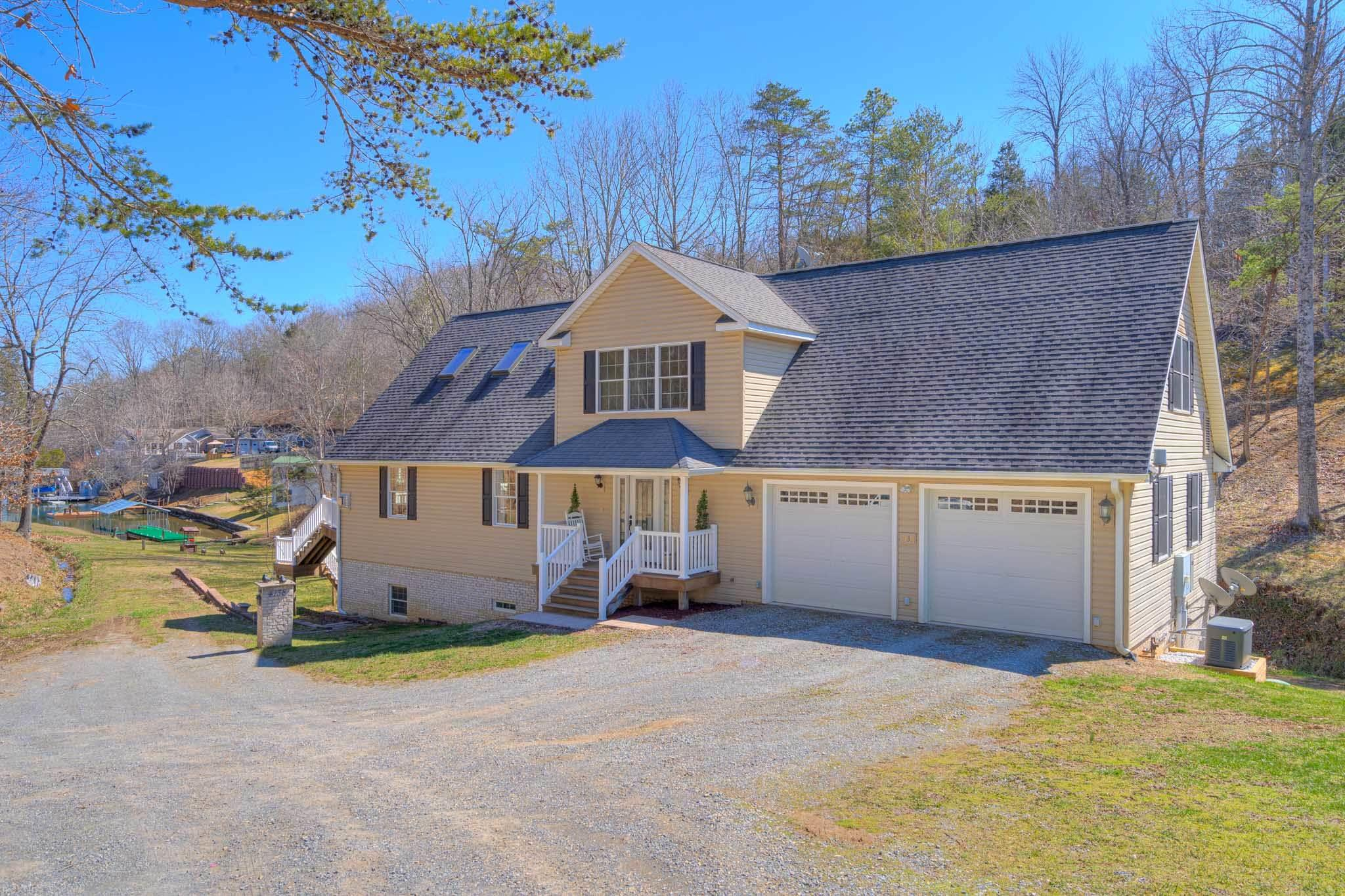 WOW! This Claytor Lake home on a protected inlet is full of upgrades, many for energy efficiency. Lake front, private dock with water and power, beautiful views! Enter into the front great room- vaulted ceilings, remote control ceiling fans, rain-sensing skylights make this room bright and spacious! Amazing heated tile floors throughout. Gourmet kitchen w/gorgeous custom cabinets, beautiful granite countertops, and a large seated island with prep sink. Enjoy lake views during your mornings or evenings on the spacious Trex deck. Laundry and MBdrm on the main; heated floors throughout Master bath, along with custom tile work, jetted tub, lg walk in clset, and shower. Upper level hosts a full guest suite, two closets, lots of windows, a full sitting room, and large full bath. Unfinished basement completely framed, plumbed, and wired for a family room, 2nd MBdrm, walk in closet, and 1/2 bath. Walk right out to the stamped patio, lake view. 8 min. to local shopping/ schools.  A MUST SEE!