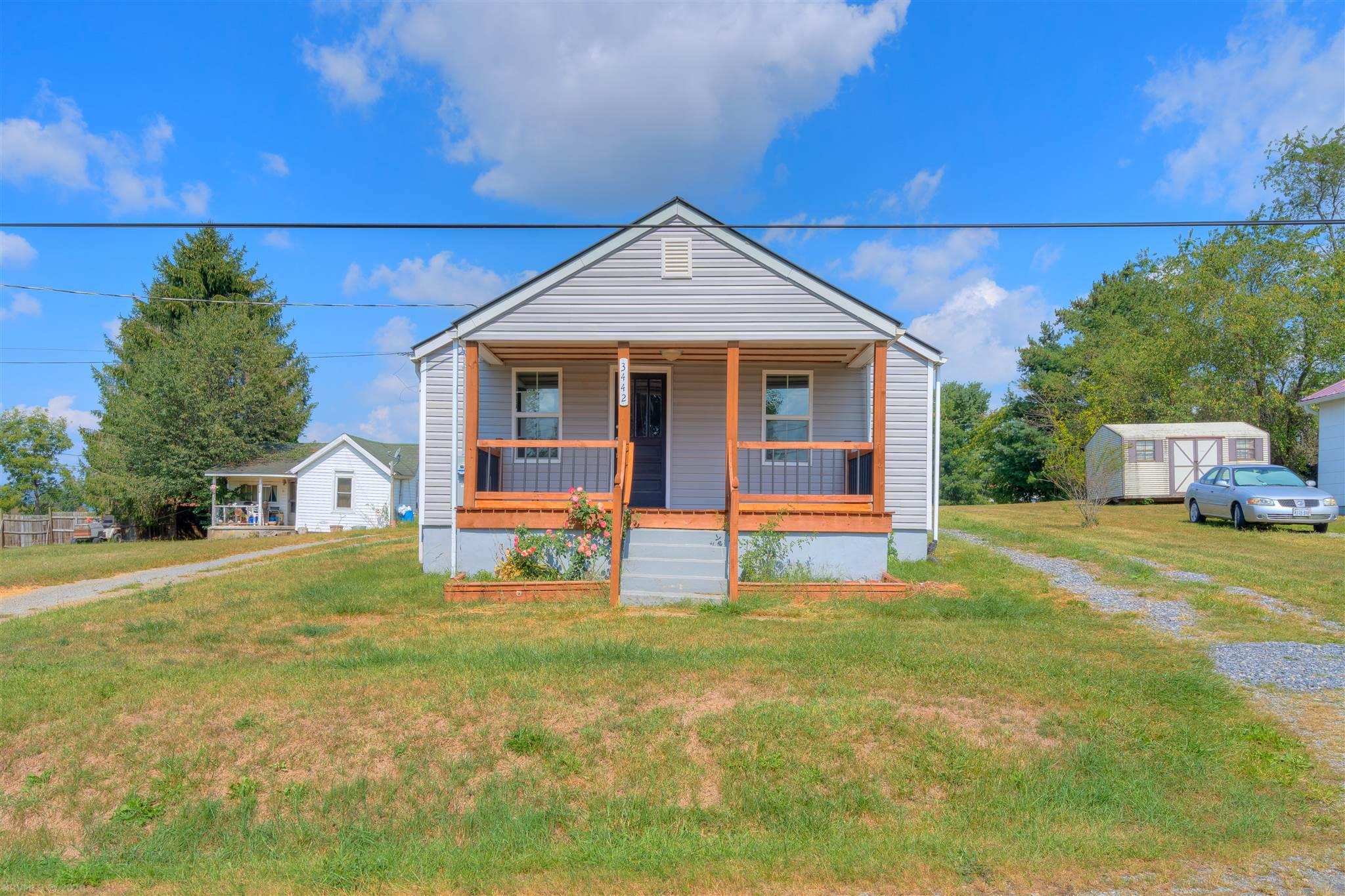 This cute 3 bedroom home has been totally redone! Located in a quiet neighborhood in Robinson Tract, you can walk up to the completely covered and brand new front porch, and enter right into the living room. Crown molding, fresh paint, new fixtures throughout. New laminate floors throughout. New Washer & Dryer, Ref, Range, Microwave all convey. Bright light through new windows in every room. Lots of closet space in each bedroom, and plenty of cabinets in the kitchen. New hot water heater, new HVAC heat pump, new vinyl siding, new roof, all new electrical and plumbing. One large outdoor storage area with shelving; two other large out buildings for storage. This is a wonderful starter home for a new family, or maybe even a sweet soul or couple looking to downsize. See it today!!
