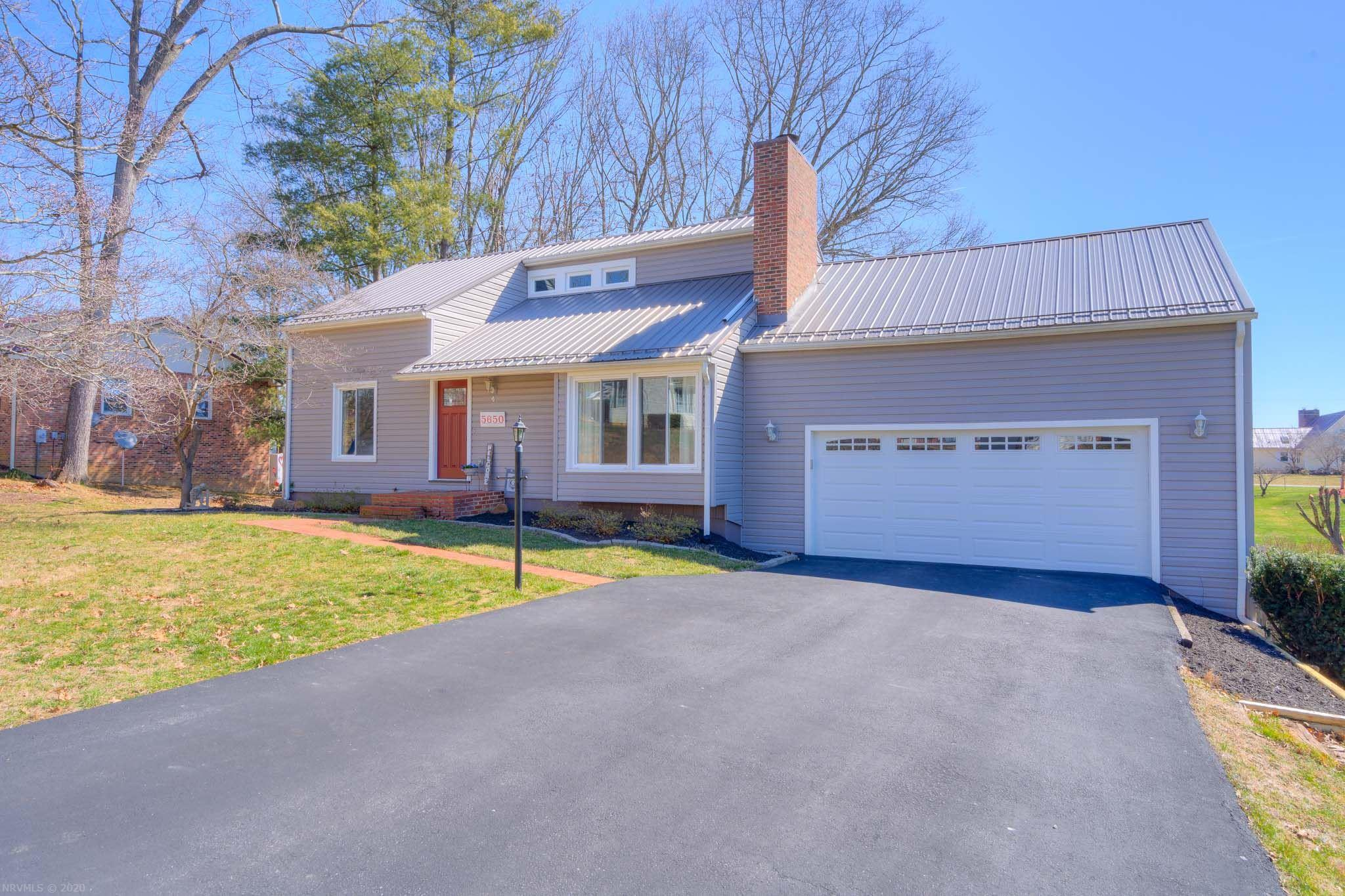 Welcome to 5650 Sharon Drive, a bright and airy contemporary ready for new owners!  The living room features a dramatic vaulted ceiling and fireplace.  The updated and open kitchen and dining space offer easy access to the garage and rear deck.  Buyers will appreciate the main floor owner's bedroom and bath, and two additional bedrooms and a bath upstairs.  Downstairs features an office/media room, oversized family room, and laundry/storage.  New windows and several doors in 2016, water heater replaced in 2017, new kitchen, bathroom fixtures, heat pump, electric panel, radon mitigation, roof, gutters, vinyl & garage door in 2015.  Sunny, fully fenced rear lawn ideal for gardening and your four-legged friends.  Be sure to click on the virtual tour link.  Loved and full of charm, this home is truly move-in ready.