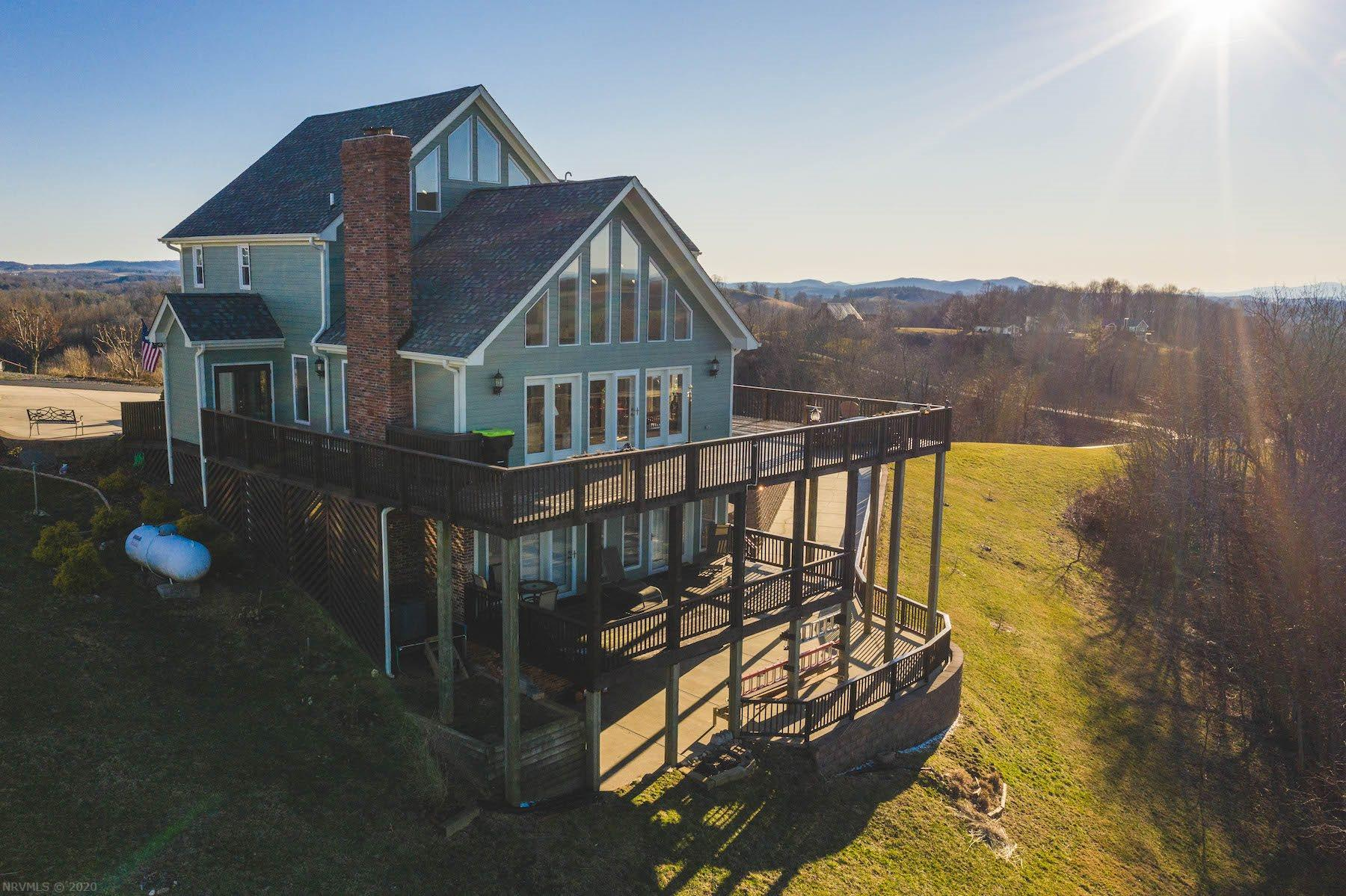 Beautiful Contemporary A-Frame home located in Hillsville VA! This stunning 5 bedroom 3.5 bath home is surrounded by a breathtaking 360 degree mountain view! The home offers modern-style living with hardwood flooring, stainless steel appliances and granite countertops.  The large picture windows provide great views of the surrounding mountain ranges.  Each bedroom is a great size providing plenty of space for family or visiting loved ones.  The attached single car garage is perfect for storage space and convenient parking.  The patio area on the main level is the perfect area to enjoy the company of family and/or friends as well as the spacious decks. This home offers million dollar views and modern-style living suitable for everyone.