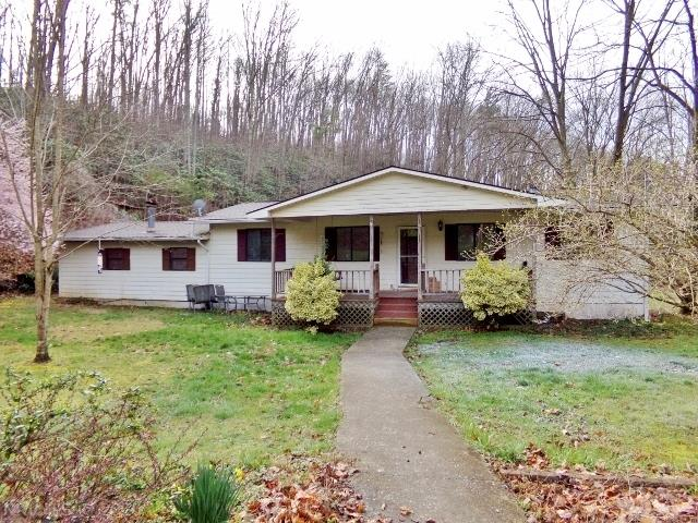 Enjoy privacy with this spacious Ranch on 2.8 acres. Relax on covered front porch & enjoy the sounds of the bubbling stream. Lovely laminate flooring. Attached Double Garage. Back Deck. Heat pump.