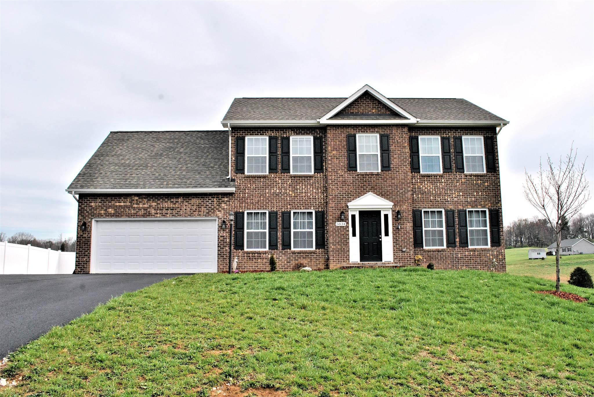 Pristine brick & vinyl four bedroom colonial in the peaceful Hogans Retreat Subdivision on corner 1.5 acre lot. This move-in ready home has a half bath & hardwood floors on main level, formal dining room, granite counters w/  pantry in kitchen & breakfast nook w/ bay window overlooking the backyard. Enjoy the convenience of the laundry on the upper floor with all of the bedrooms. The master bedroom has an enormous walk-in closet & master bath complete with double sinks & tiled walk-in shower. Bring in your groceries from the two-car attached garage directly into the kitchen & enjoy warm evenings on the rear deck. There are two heat pumps for zoned heating and a large 12x24 outbuilding and built-in play set. The unfinished walk-out basement has been plumbed for an additional bath & can be finished to create more living space. There is an over-sized paved driveway w/ white vinyl privacy fence for parking a camper. A gorgeous home in the Auburn school district that is better than new!