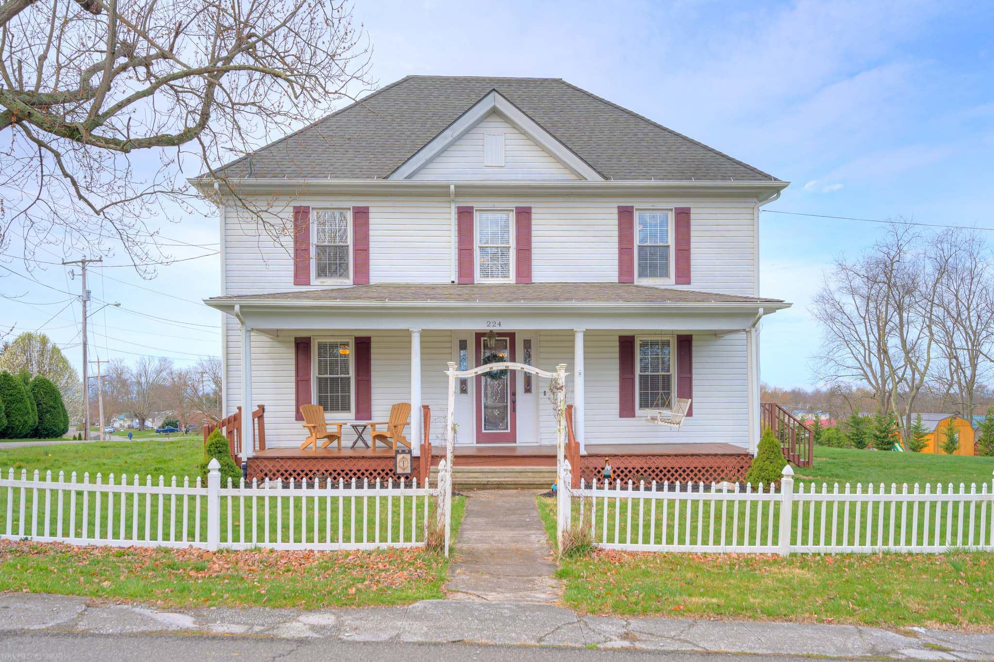 This beautiful updated farmhouse will take your breath away! Large covered front porch welcomes you through a magnificent entrance into a spacious foyer. Visit the formal sitting area w/ fp and built in bookcases. Gleaming hardwoods throughout the main lead into the large, bright, modern kitchen with custom cabinets, gorgeous granite counters, island, and gas stove. Large separate formal dining area perfect for family gatherings! Master on the main with private bath, tiled shower, and large walk in can also serve as a guest bedroom!  Laundry on the main, half bath and mud area by the back door. Head up the wide polished stairway to another bright Master bedroom, with private bath- tiled shower, claw footed tub and double back saver sinks. Two more large, bright bedrooms and additional staircase to a floored attic with plumbing that is ready to finish. Crown molding, custom woodwork, high ceilings and modern fixtures showcase a decorator's touch. This one won't last long- see it today!