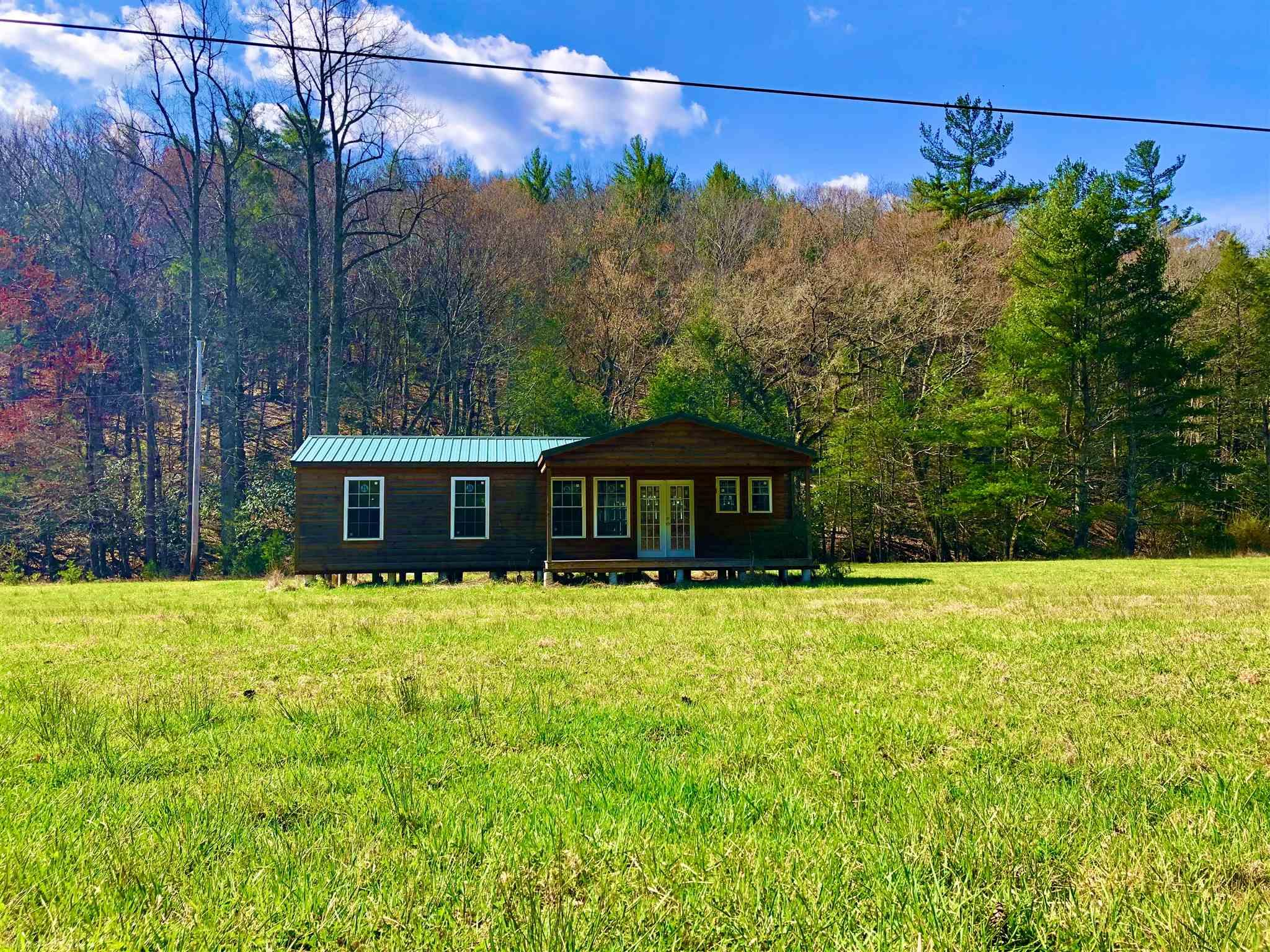 Welcome to Paradise! This property is perfect for your dream home or weekend retreats! Full tract is over 26 acres; approx 6 of those acres are cleared,level, and ready for you to build on! Electric & phone already on property and land has perked! Take in the breathtaking 360° Mountain Views and serene sound of Spur Branch Creek that runs along the property! The remaining wooded acreage offers large timber and is perfect for hunting! Approx. 500sf Newer Cabin conveys with the property. This property is zoned A1 with no restrictions, perfect for horses or livestock! Conveniently located right off of Little Creek Highway, and approx 822ft of road frontage on Spur Branch Rd.