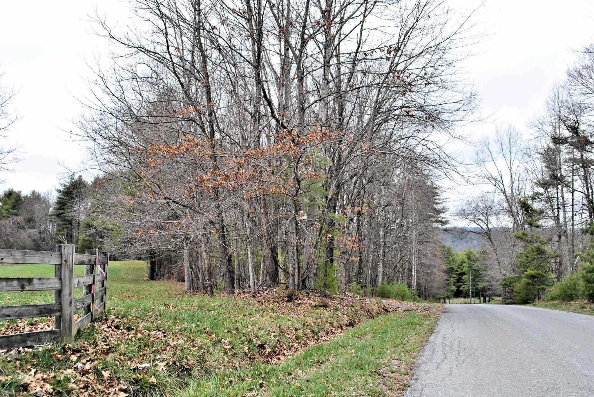 This nice lot in Floyd has almost 9 acres of land that lays well and has long road frontage on paved state maintained road.  Property is a mixture of open land, hardwoods and planted spruce trees with a nice spring.  Great mountain views.  Many different building sites.  New survey on file.