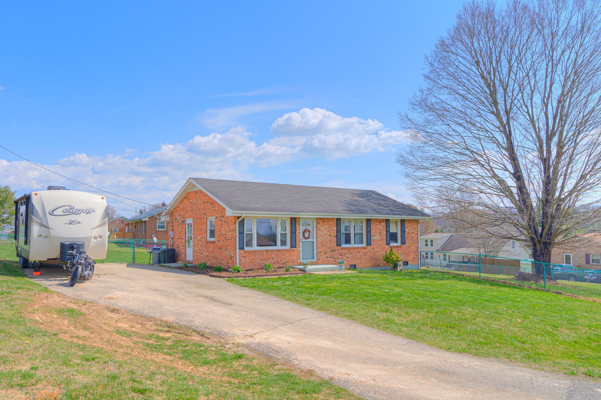 All brick ranch in dynamic Dublin location with easy access to Volvo, Randolph Park, New River Community College, Radford University, Calfee Park and Claytor Lake. One lucky buyer is going to enjoy a bright open living room with serving bar to a delicious kitchen plus three cozy bedrooms. Extra-large corner lot with fully fenced backyard and a storage shed.