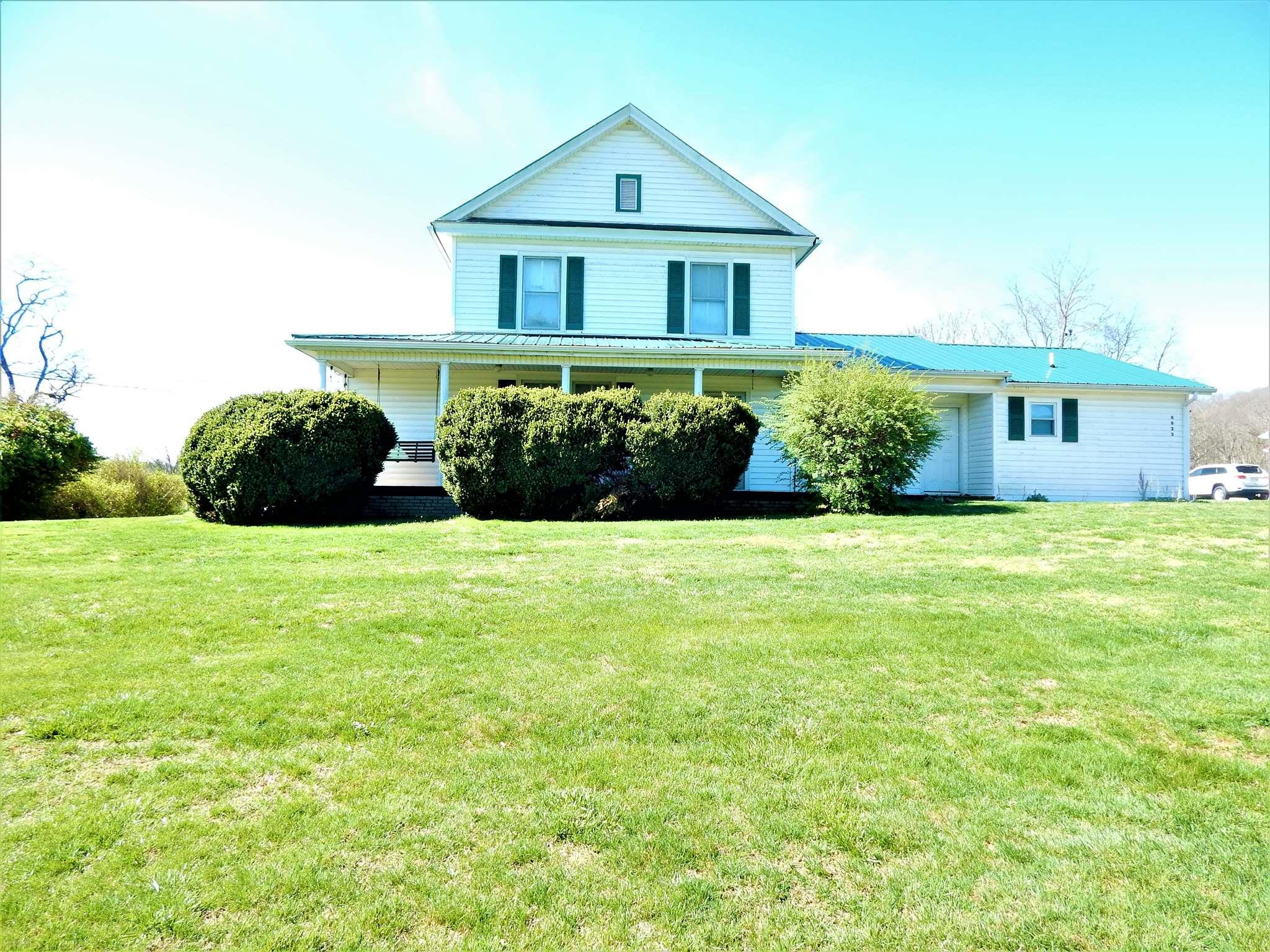 A unique opportunity awaits the lucky Buyer of this home. A five bedroom, twelve room home with beautiful pine flooring in upper-level bedrooms.  The room sizes and location provide a wonderful opportunity for creative use . . offices, hobby rooms, library . . . you name it and use it!  A detached garage, storage shed and outbuildings complement the multiple possible uses of this property.