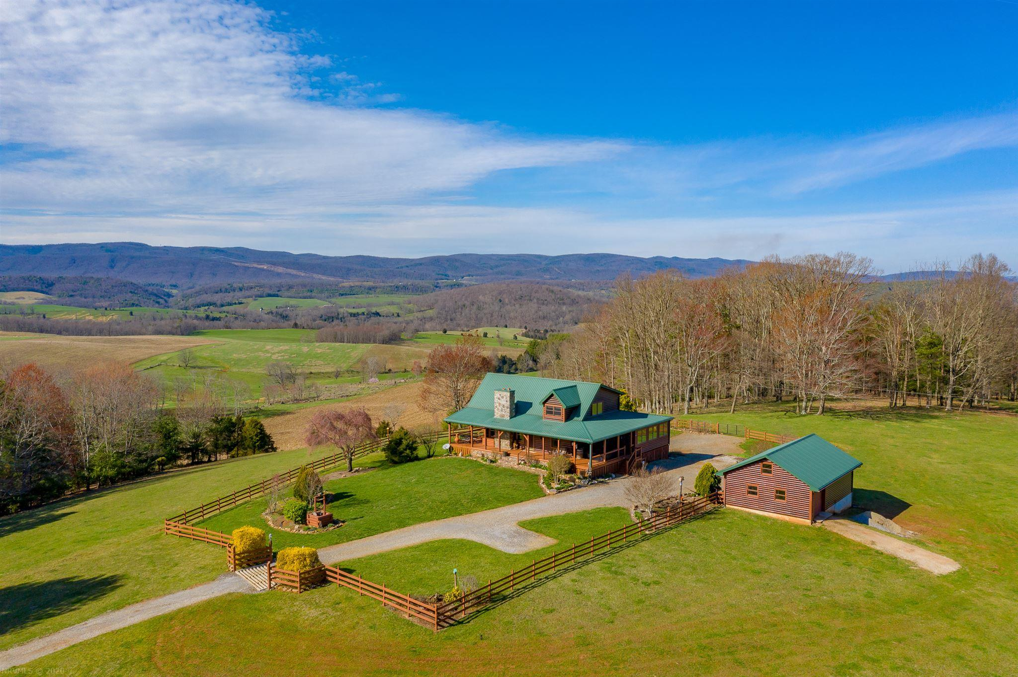 Privacy, Mountain Views & borders the Jefferson National Forest. This log home on 22+ acres truly has everything you could want in a mountain retreat. Located just 20 min. from the I-81/I-77 intersect & 30 min. to Downtown Wytheville it is an absolute wonder that you can be so close to amenities yet have complete privacy at your home. The mountain views span for miles and you would be hard pressed to find another home in your view. The main level features an open floor plan with cathedral ceiling, wood burning fireplace, wrap around covered deck, bedroom, full bathroom, laundry and sunroom. Upstairs is a loft/sitting area that is open to the main level and gives access to the master suite. On the lower level is 2 additional bedrooms, full bathroom, workshop, cellar and recreation room/gym. Next to the house is a 36' X 24' garage with a 2 car garage door on the front and a single car garage door that goes to the pasture. There are streams, woods and pasture offering everything you need.