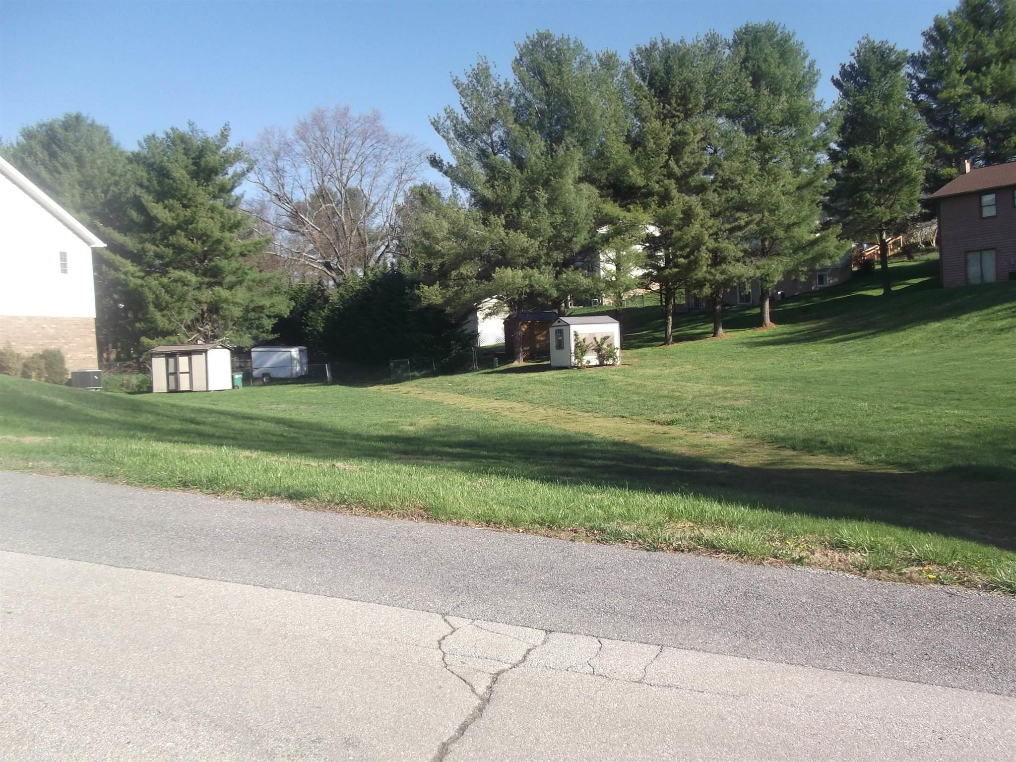 1.4 acre lot zoned R-2 to allow a duplex or a nice large building lot for a secluded home.  Level lot with mature trees. Driveway entrance on Pine Street.   Other possibilities may exist.