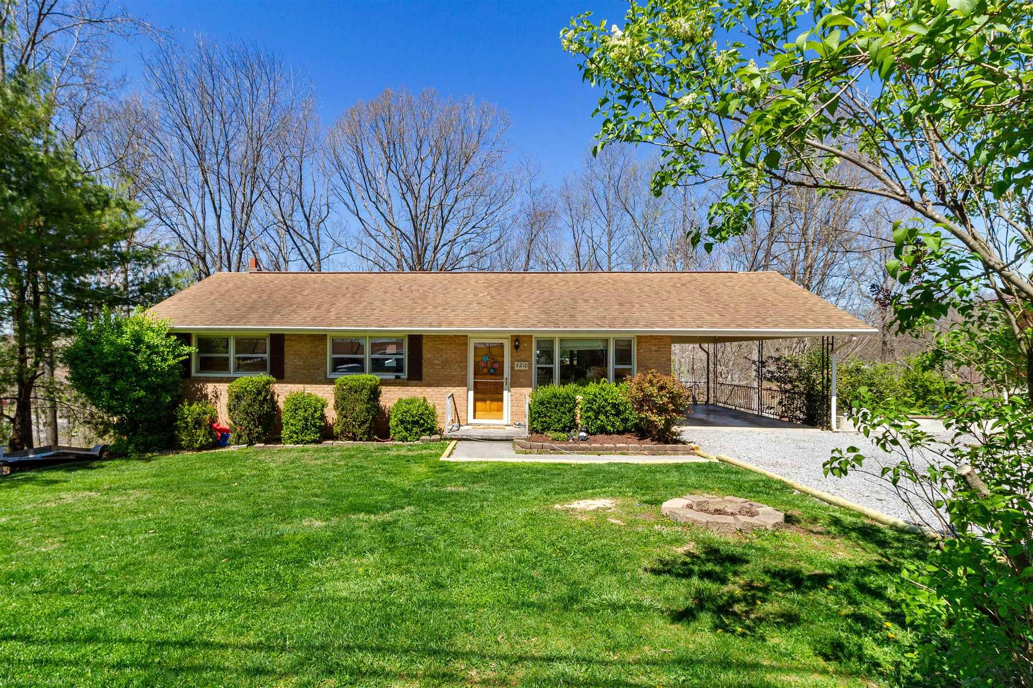 Don't miss this lovely brick ranch in a great location in Christiansburg: convenient to 460, I-81 and just 9 miles to Blacksburg. The full basement is finished with a great den or spare bedroom space, built in bar, and tons of storage! The open kitchen/dining area has a new electric range and overhead microwave that were installed in 2019. This home has a beautiful flat front yard, a partially covered back deck off of the dining room & kitchen that overlooks the backyard, and an enclosed patio with a hot tub perfect for a relaxing evening! The hot tub is only 3 years old and fits 5-6 people. The hardwood floors on the main level were refinished in 2018, the Heat Pump was replaced in 2014 and the hot water heater was replaced in 2019. In 2019, home was also connected to town sewer - a great upgrade! The gas logs in the basement convey along with two propane tanks.