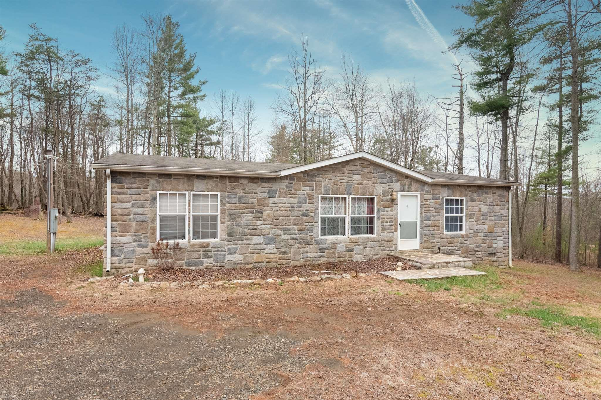 Come and look no further for your next home. 3BR, 2BA double wide with enough space outside to roam. Close to land that features 200 acres of four-wheeling and 400 acres of hunting space. Deck and firepit out back for gatherings. Charming wood fort. Shed for extra storage.